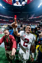 Alabama quarterback Jalen Hurts signals No. 1 as he waves to his family after defeating Georgia in the SEC Championship Game at Mercedes Benz Stadium in Atlanta on Saturday, Dec. 1, 2018.