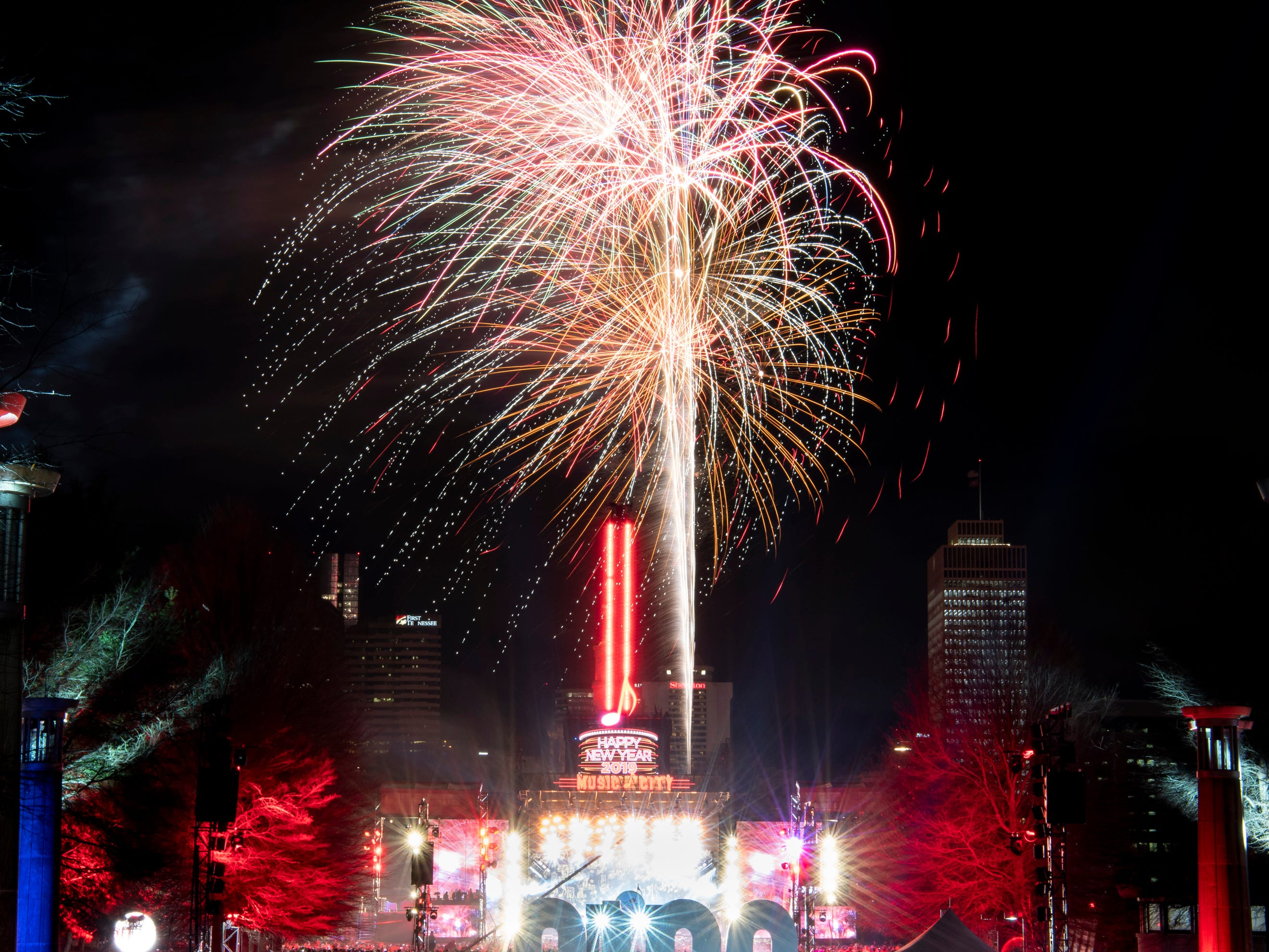 Fireworks light up the sky during the Jack Daniel's Music City Midnight: New Year's Eve event at Bicentennial Capitol Mall State Park in Nashville, Tenn., Tuesday, Jan. 1, 2019.