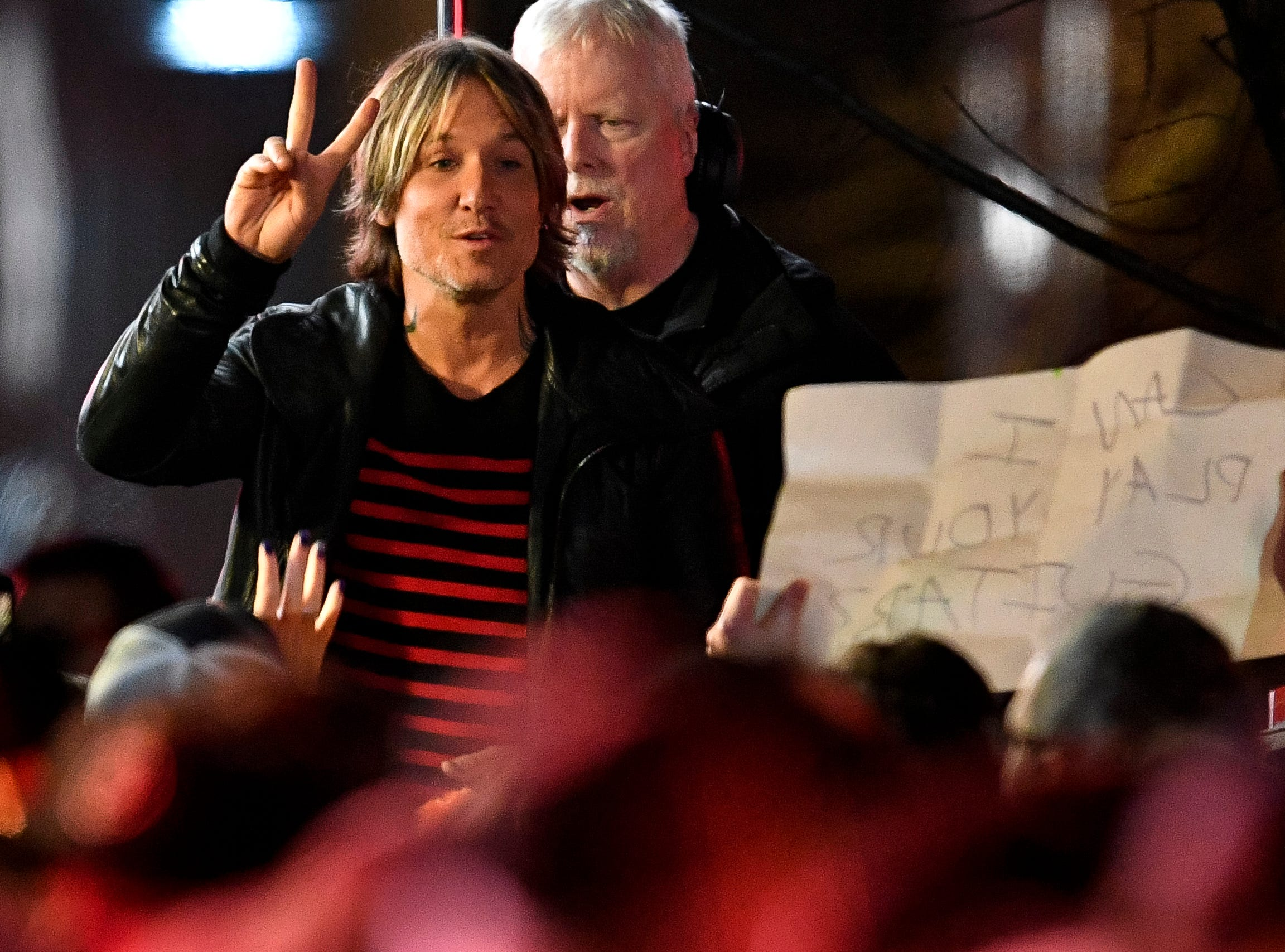 Keith Urban waves to fans during the Jack Daniel's Music City Midnight: New Year's Eve event at Bicentennial Capitol Mall State Park in Nashville, Tenn., Monday, Dec. 31, 2018.