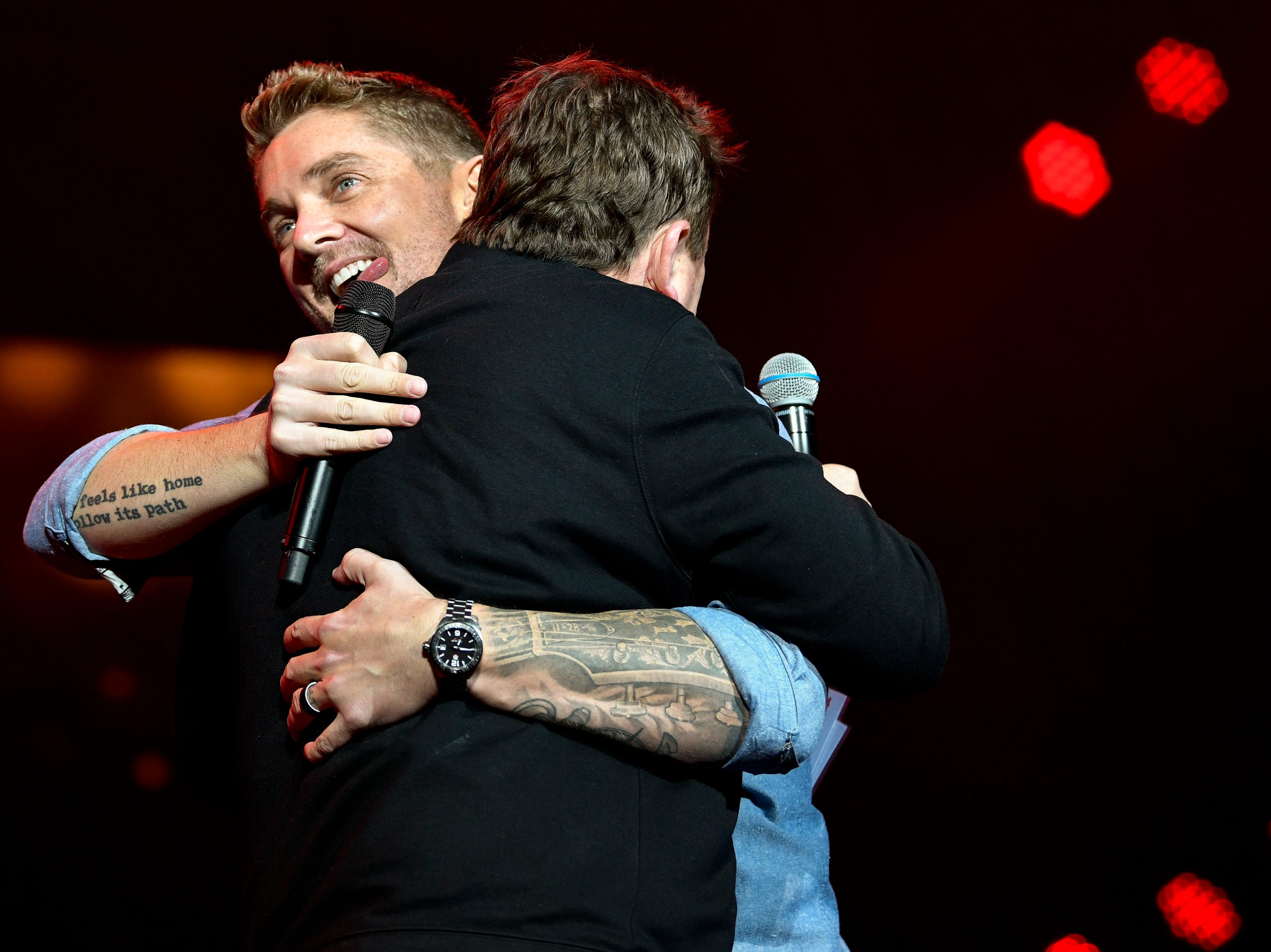 Brett Young, left, hugs Storme Warren, right, during the Jack Daniel's Music City Midnight: New Year's Eve event at Bicentennial Capitol Mall State Park in Nashville, Tenn., Monday, Dec. 31, 2018.