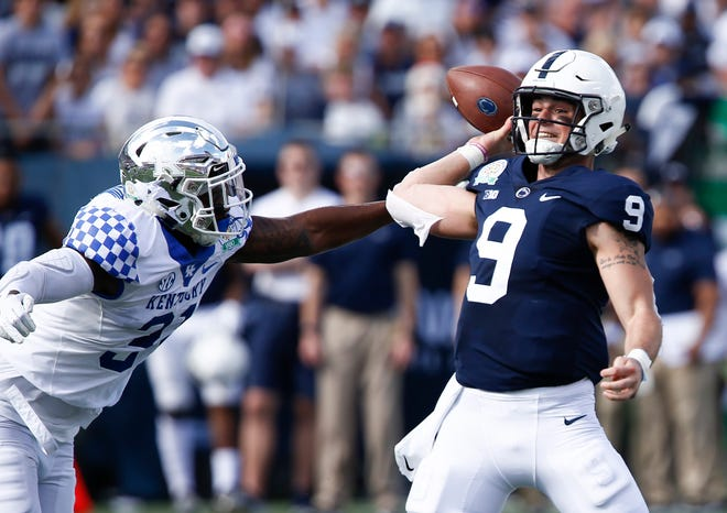 Kentucky Wildcats linebacker Jamar Watson (31) puts the pressure on Penn State Nittany Lions quarterback Trace McSorley (9) during the first quarter in the 2019 Citrus Bowl at Camping World Stadium.