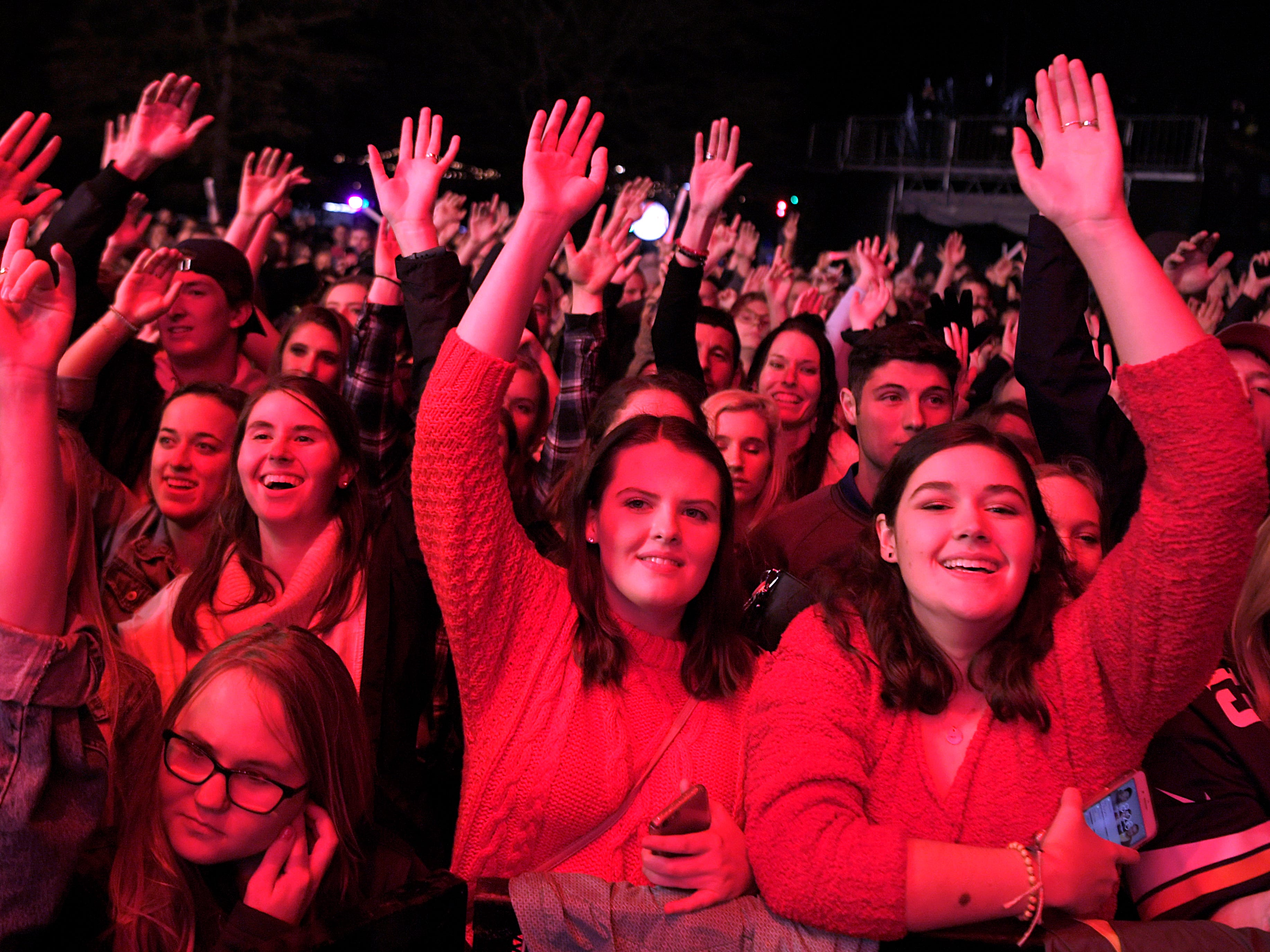 Judah & the Lion music fans waves their arms to the music as the Nashville band performs during Jack Daniel's Music City Midnight: New Year's Eve at Bicentennial Capitol Mall State Park in  Nashville on Monday, Dec. 31, 2018.