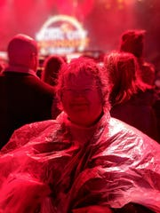 "Jackie Reuter came prepared for the Music City Midnight concert with a poncho. She claims to be Keith Urban's ""biggest fan."""