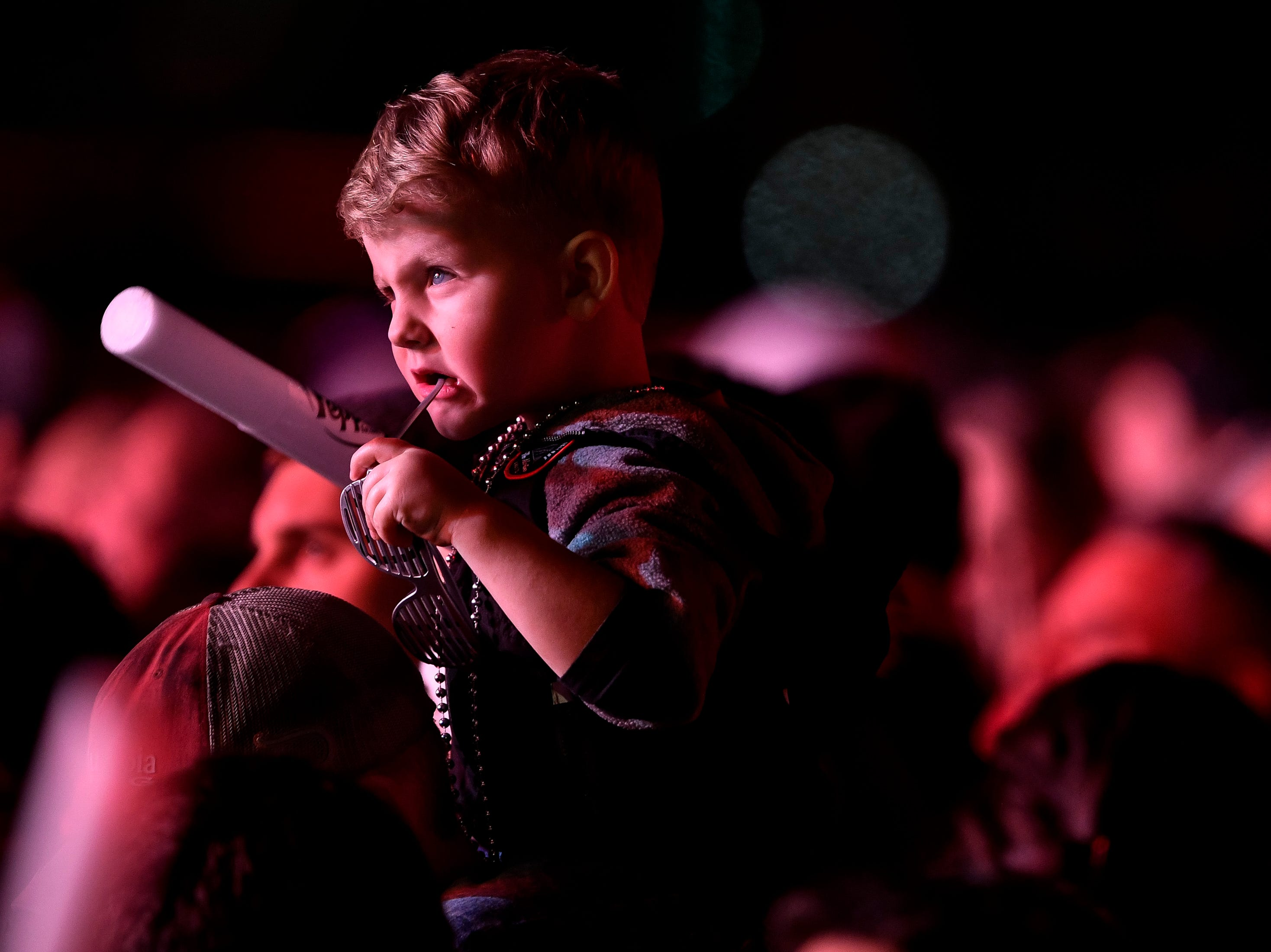 A young fan waits for Peter Frampton to take the stage during the Jack Daniel's Music City Midnight: New Year's Eve event at Bicentennial Capitol Mall State Park in Nashville, Tenn., Monday, Dec. 31, 2018.