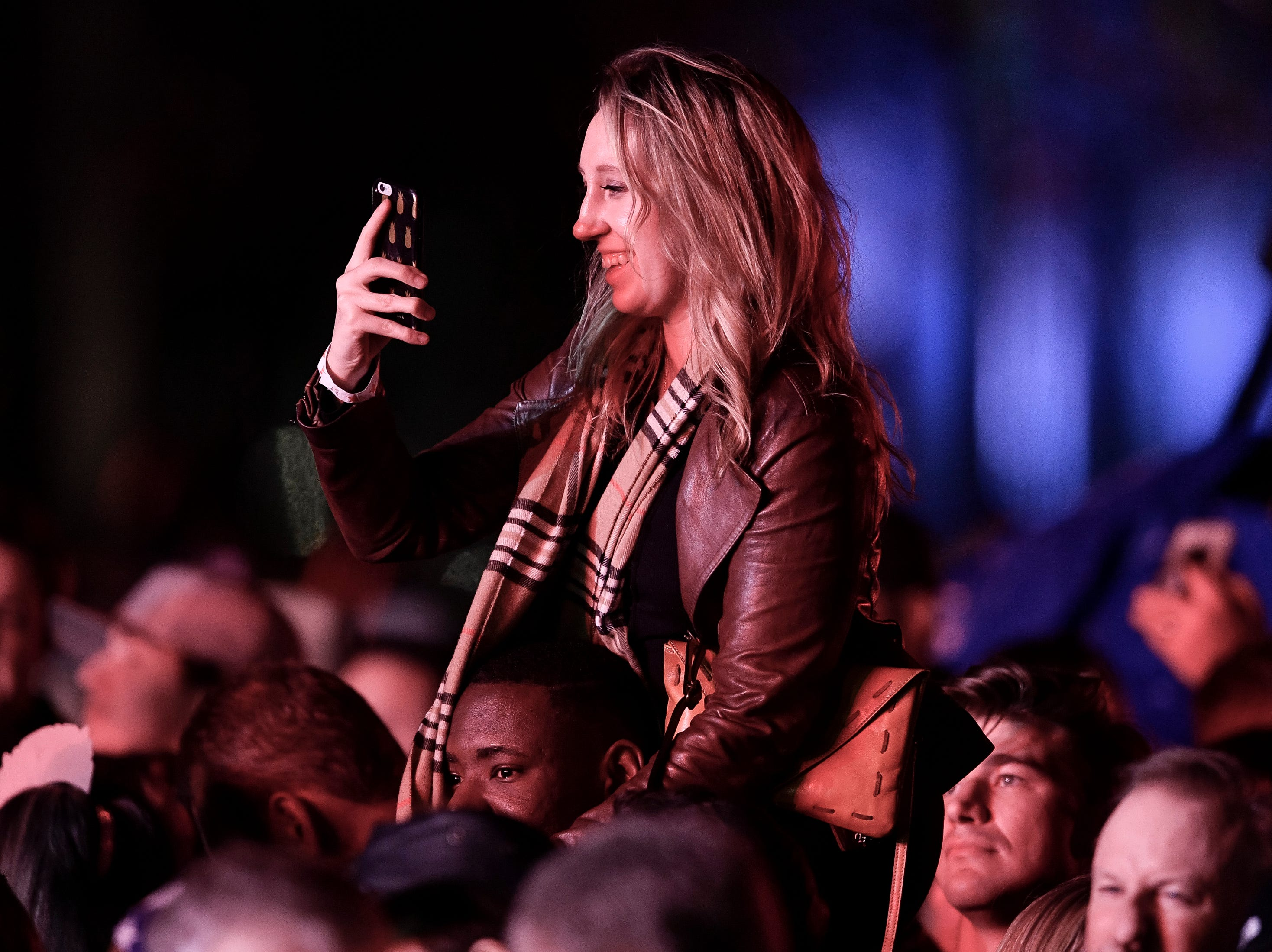 A fan waits for Peter Frampton to take the stage during the Jack Daniel's Music City Midnight: New Year's Eve event at Bicentennial Capitol Mall State Park in Nashville, Tenn., Monday, Dec. 31, 2018.