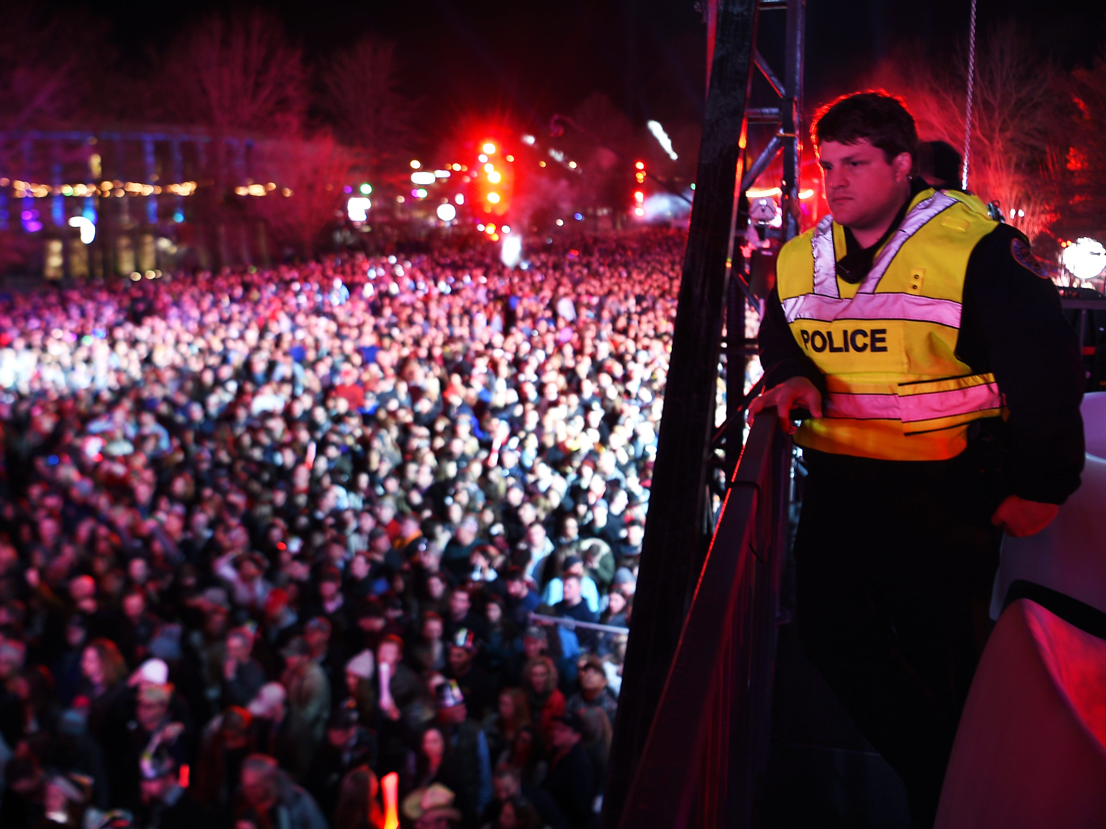 Nashville police watch the crowd during the Jack Daniel's Music City Midnight: New Year's Eve at  Bicentennial Capitol Mall State Park in  Nashville on Monday, Dec. 31, 2018.