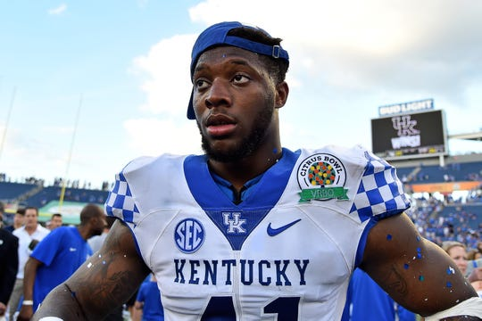 Kentucky Wildcats linebacker Josh Allen (41) looks on after defeating the Penn State Nittany Lions in the 2019 Citrus Bowl at Camping World Stadium.