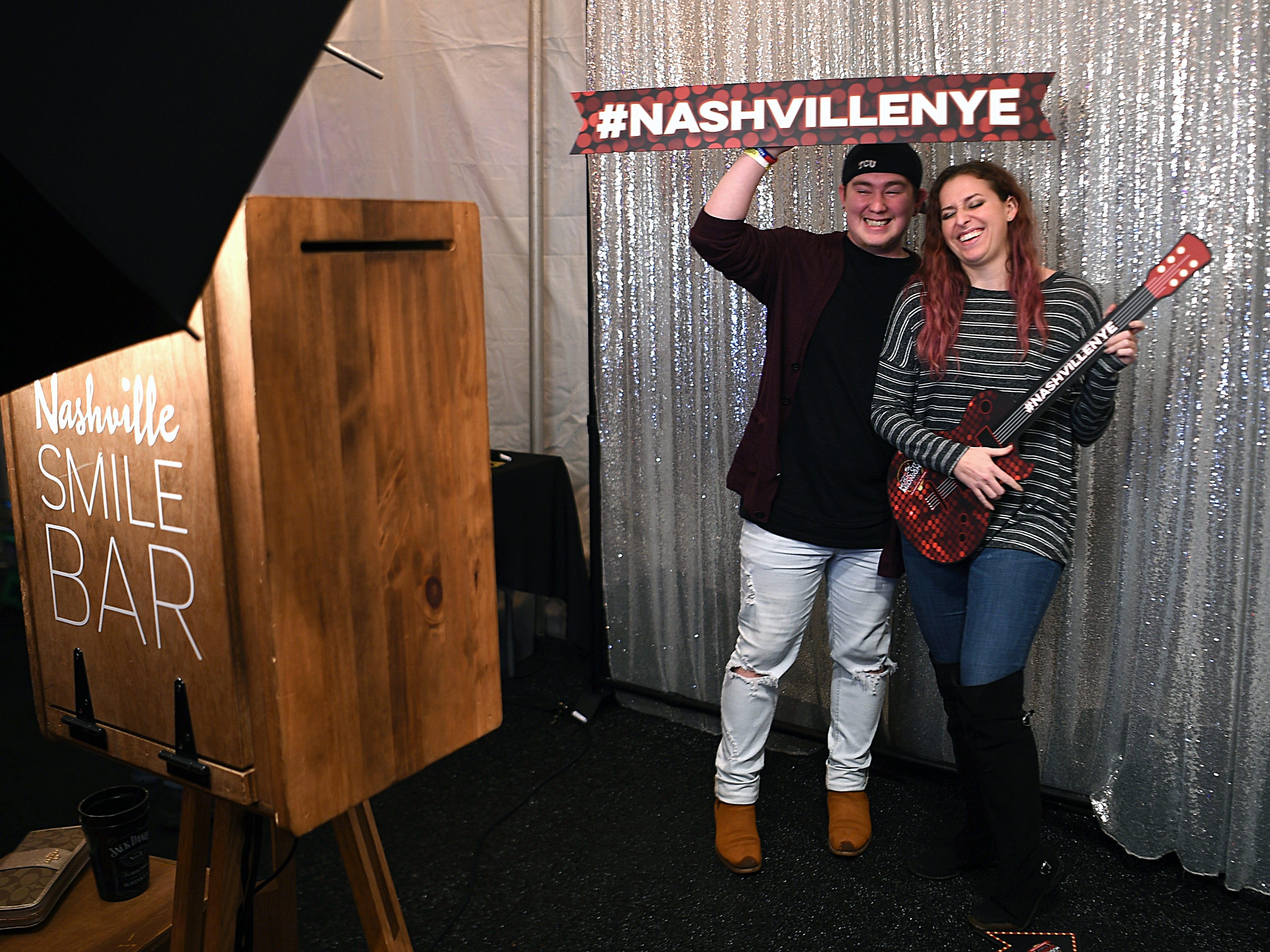 Rual Marez and Haylee Taueau of Dallas pose in the Nashville Smile Bar at the Jack Daniel's Music City Midnight: New Year's Eve at  Bicentennial Capitol Mall State Park in Nashville on Monday, Dec. 31, 2018.