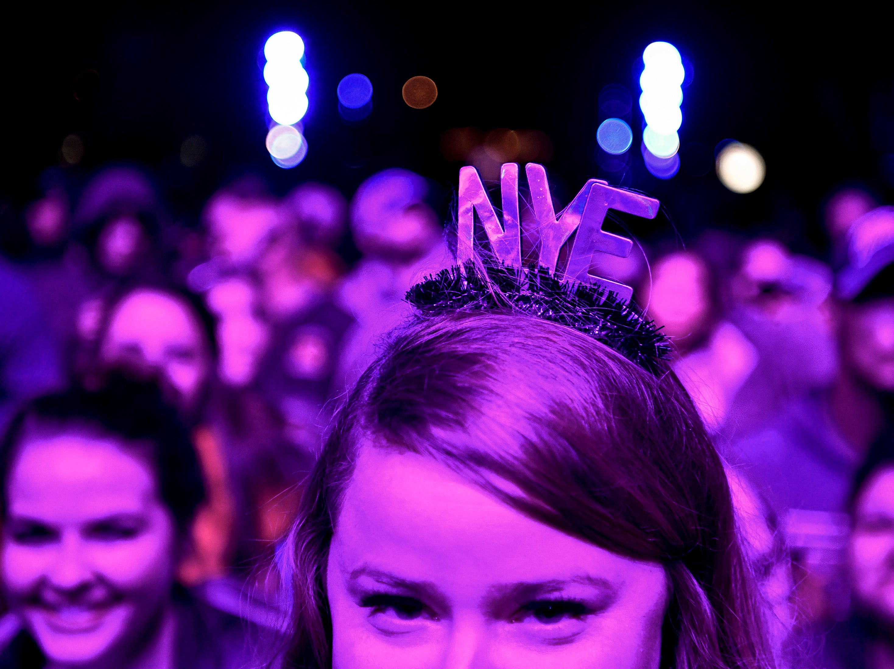 Cecilia Dubuisson, of Memphis, Tenn., watches DJ Robert Luke perform during the Jack Daniel's Music City Midnight: New Year's Eve event at Bicentennial Capitol Mall State Park in Nashville, Tenn., Monday, Dec. 31, 2018.