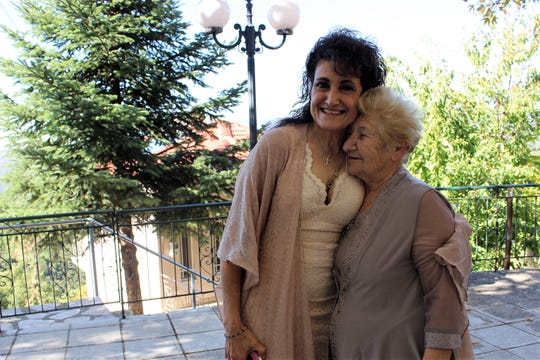 Linda Carol Trotter, left, hugs her birth mother, Charikleia Noula Foka, days after they were reunited in Greece in June 2017.