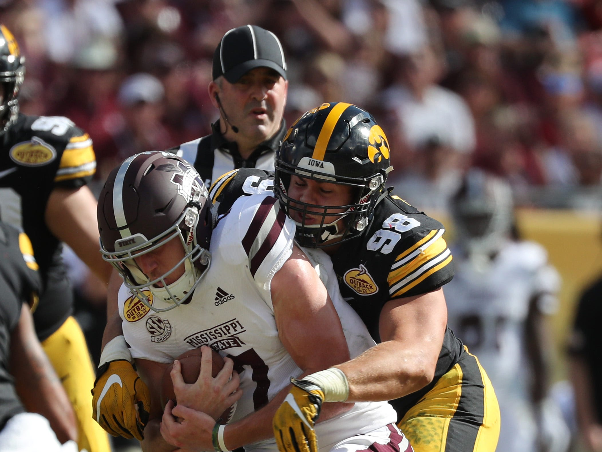 Jan 1, 2019; Tampa, FL, USA; Iowa Hawkeyes defensive end Anthony Nelson (98) tackles Mississippi State Bulldogs quarterback Nick Fitzgerald (7) during the second quarter in the 2019 Outback Bowl at Raymond James Stadium.