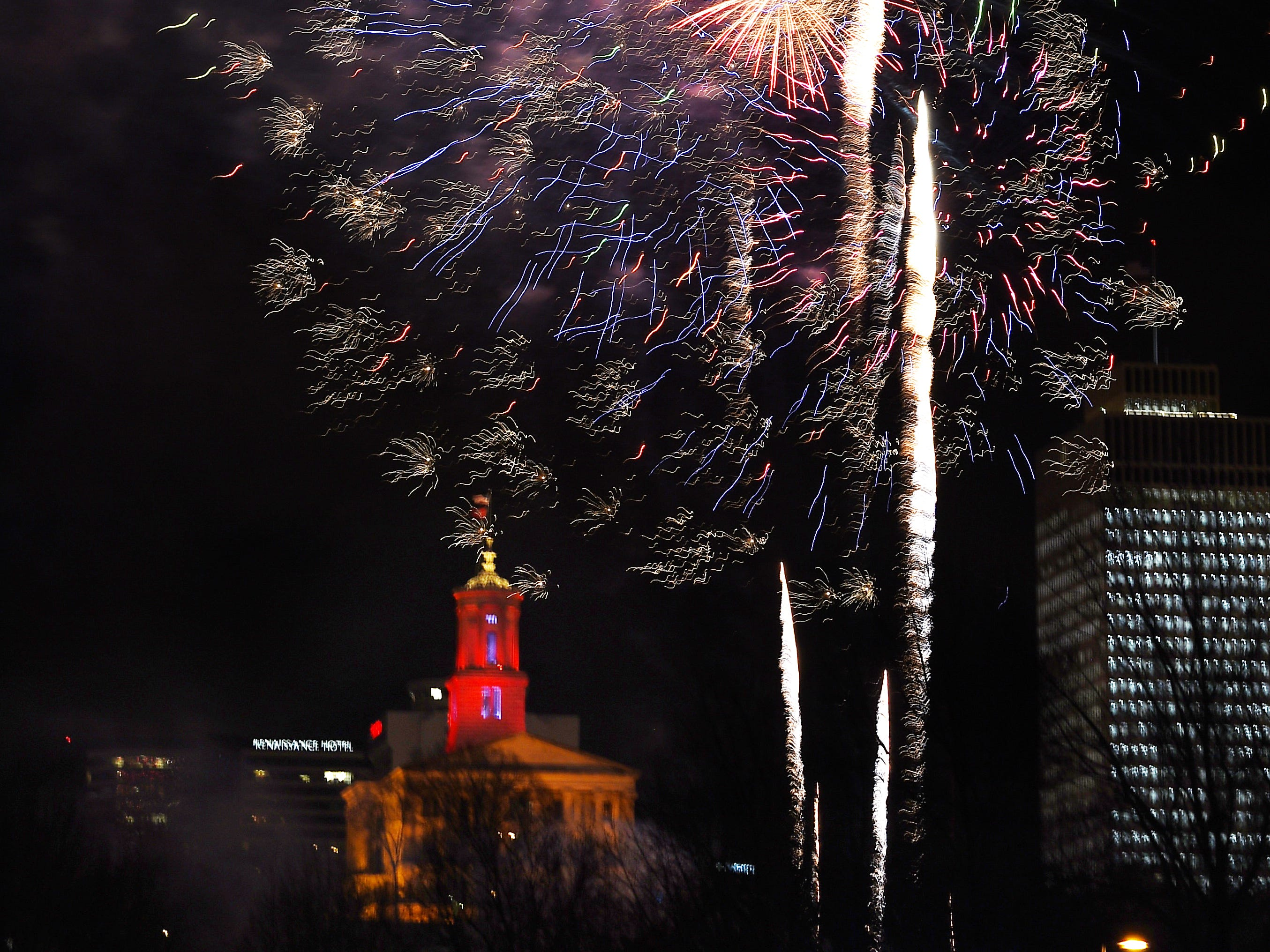 Fireworks light up the sky near the Tennessee State Capitol during the Jack Daniel's Music City Midnight: New Year's Eve at  Bicentennial Capitol Mall State Park in  Nashville on Tuesday, Jan. 1, 2019.