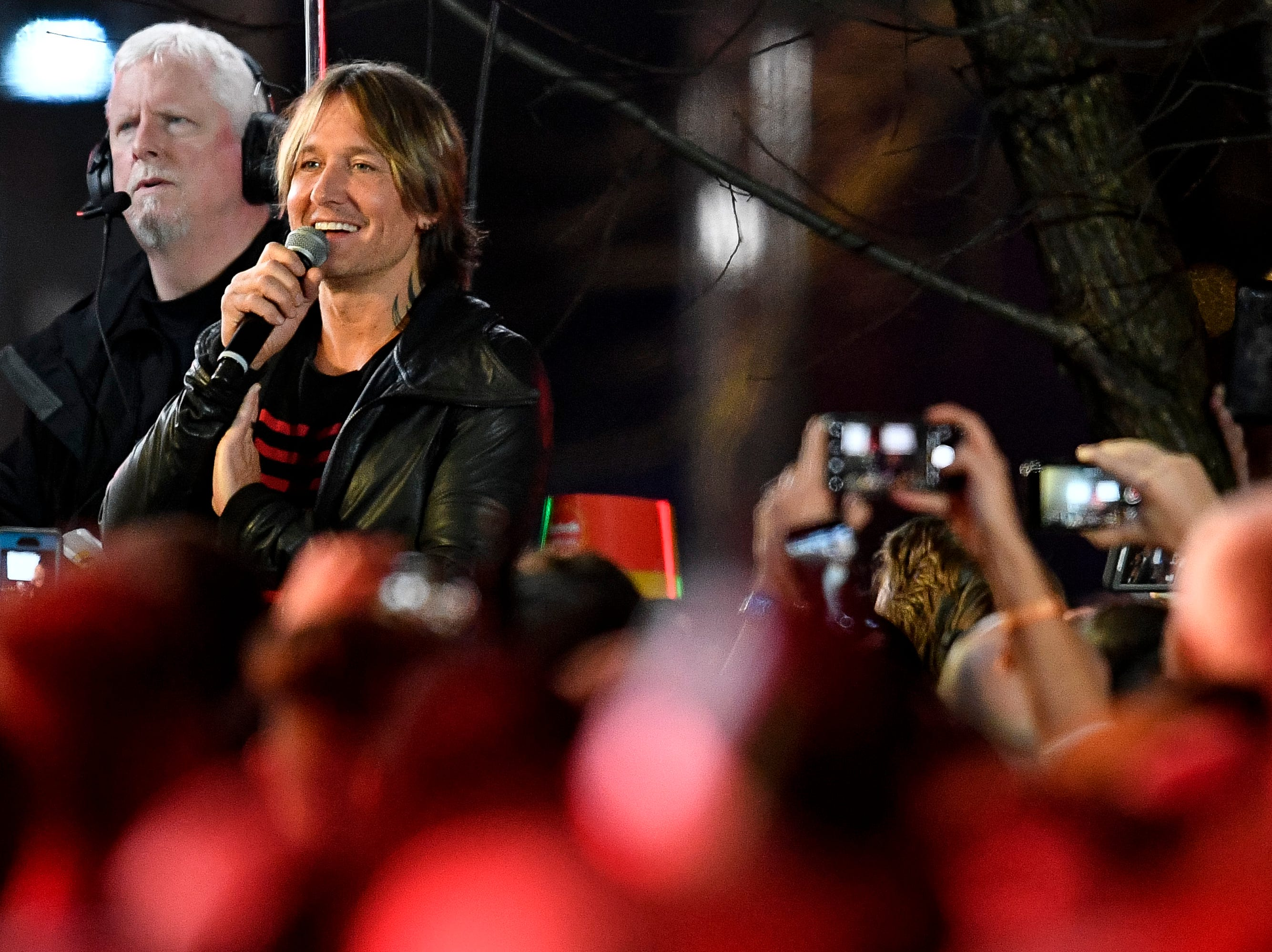 Keith Urban greets fans during the Jack Daniel's Music City Midnight: New Year's Eve event at Bicentennial Capitol Mall State Park in Nashville, Tenn., Monday, Dec. 31, 2018.