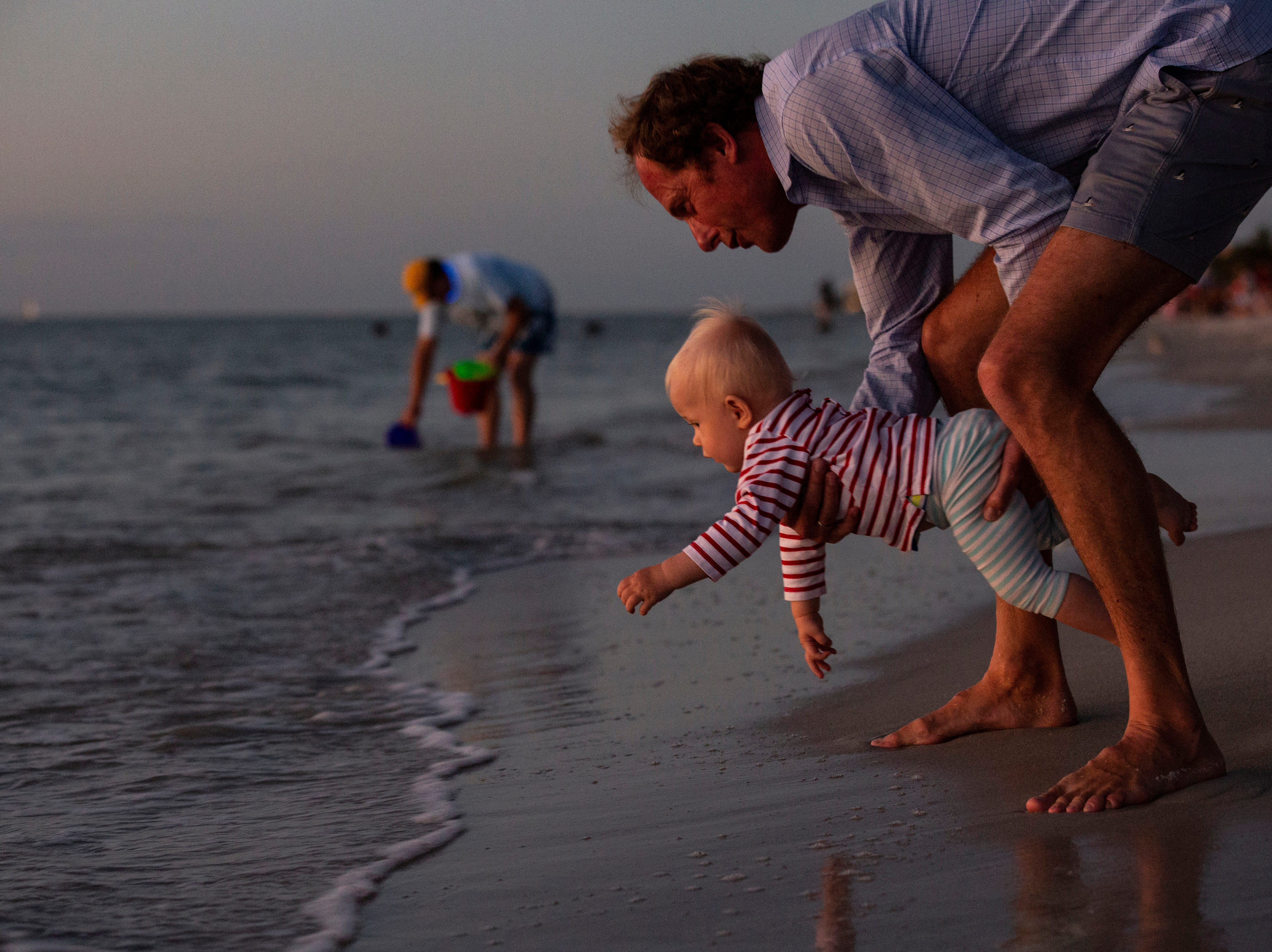 Ari Dorrestijn and his 12-months-old son, Sebastian, experience their first New Year's Eve in Florida on Monday, Dec. 31, 2018, at the Naples Pier beach. The Dorrestijn's traveled from New York to be with their family in Florida to celebrate the year's end.