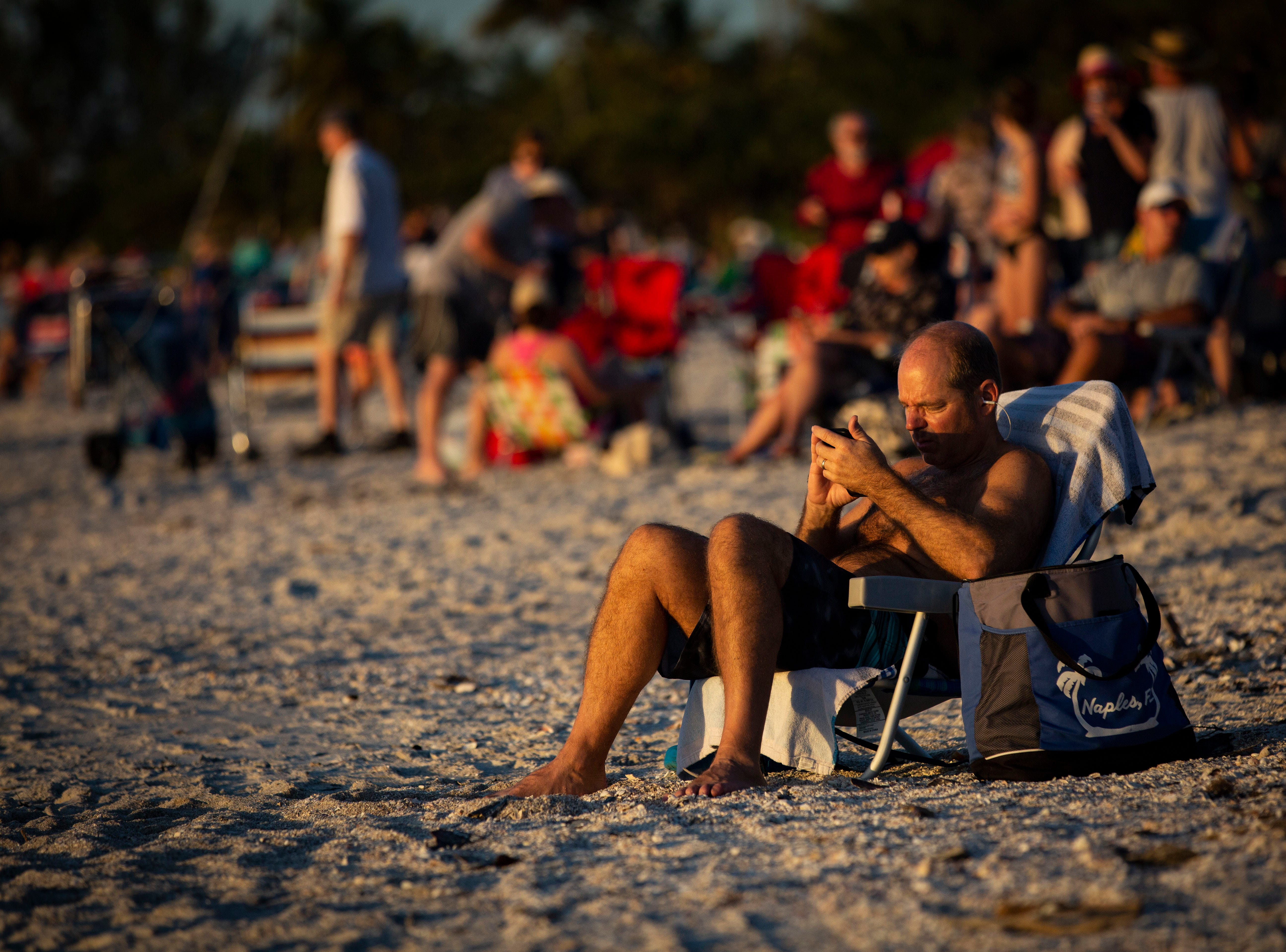 Thousands gather at Naples Pier overlooking the Gulf of Mexico, to celebrate the last day of the year enjoying the sun, the sand and the firework display put on by the City of Naples, with family and friends on Monday, Dec. 31, 2018.