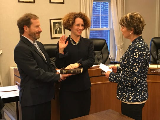 Michelle Kaufman, center, taking the oath of office, flanked by her husband, Steven Shalit. Assemblywoman Lisa Swain delivered the oath.