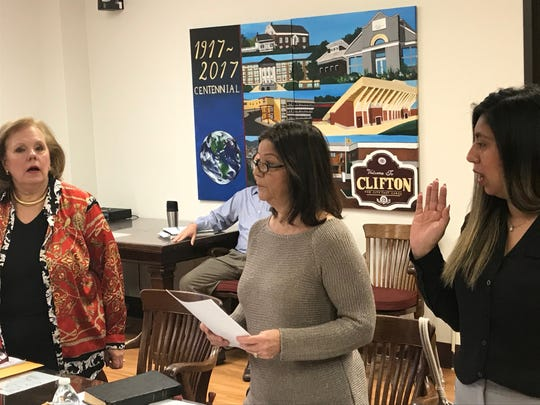 City Councilwoman Mary Sadrakula, left in January, with Councilwoman Rosemary Pino, as they were sworn into office by City Clerk Nancy Ferrigno.