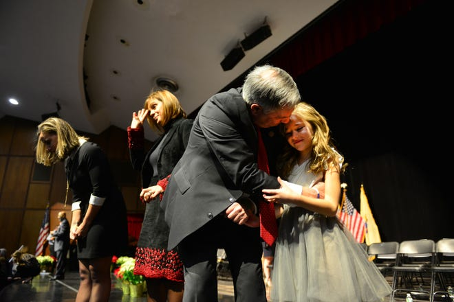 Bergen County Executive James Tedesco kisses his granddaughter Brynn Santos before his swearing in ceremony at the Bergen County Academies in Hackensack, on Tuesday January 1, 2019.