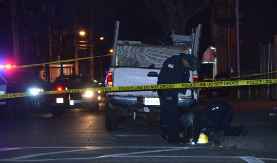 Police investigate a report of shots fired in Passaic on Jan. 1, 2019.