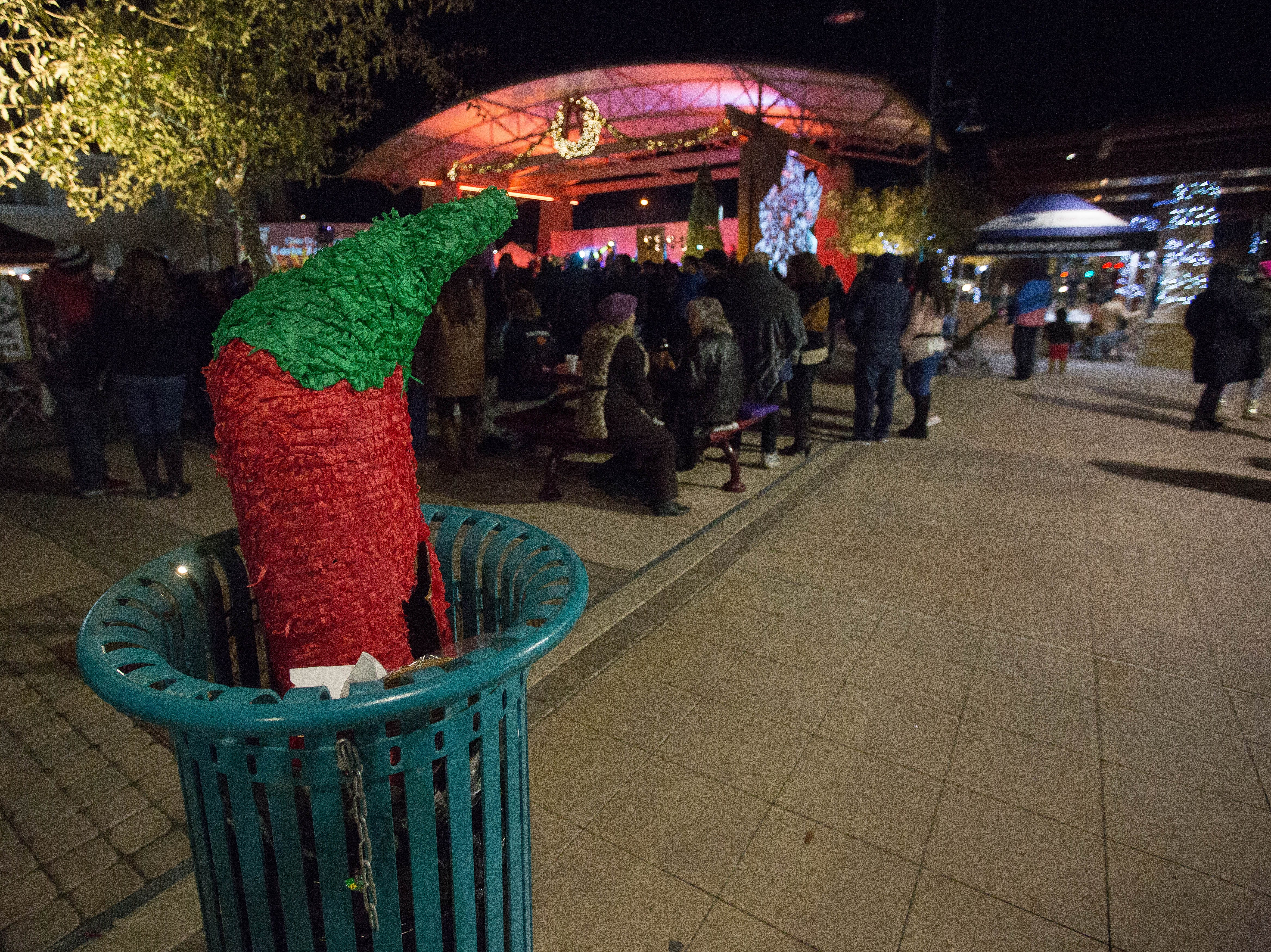 A red chile piñata in a trash can on the Plaza de Las Cruces, Monday December 31, 2018, as the Chile Drop festivities start up.