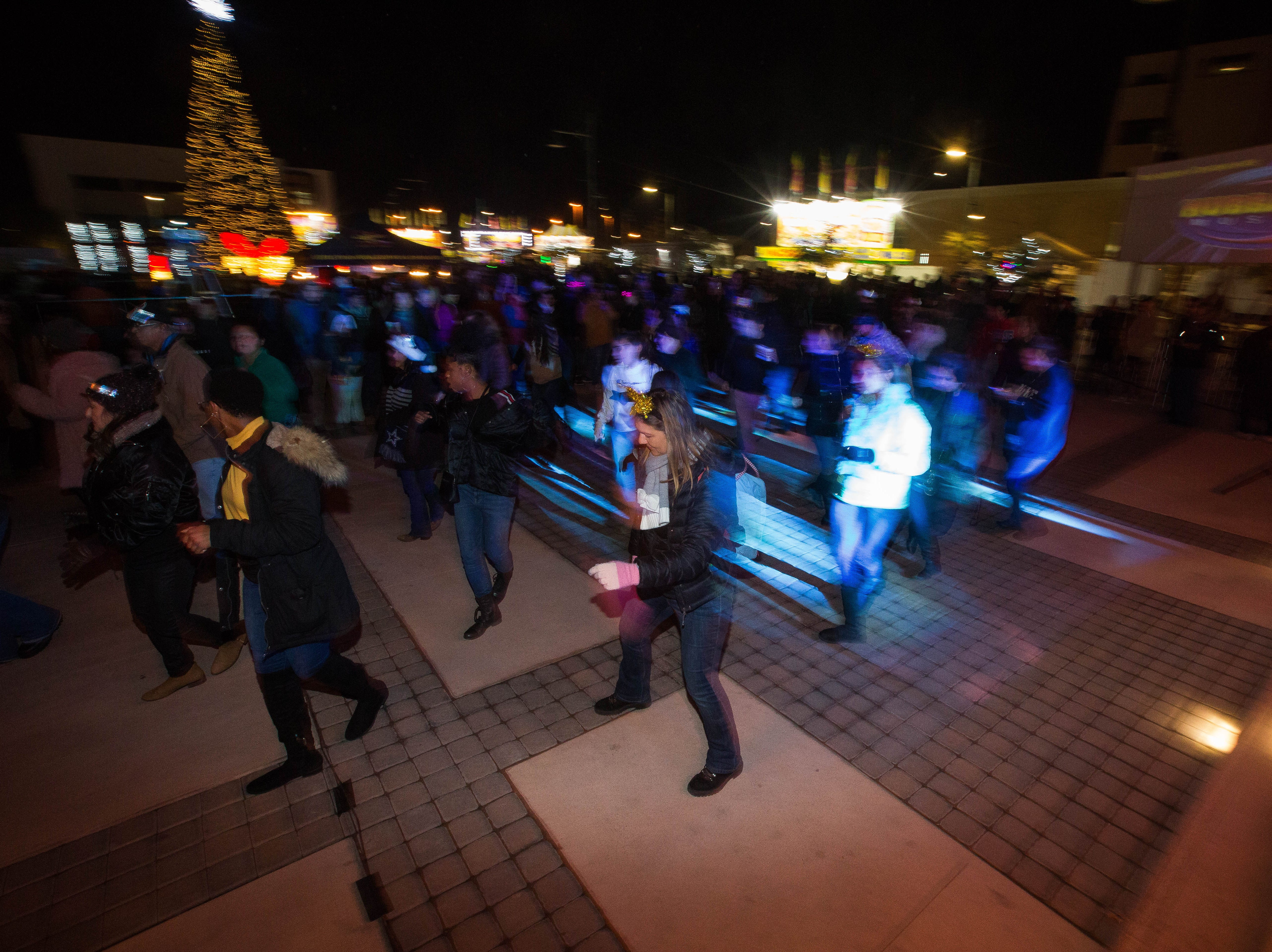 "Las Crucens dance to the ""Cha Cha Slide"" during the fifth annual Chile Drop celebration at the Plaza de Las Cruces to celebrate the New Year, Monday December 31, 2018."