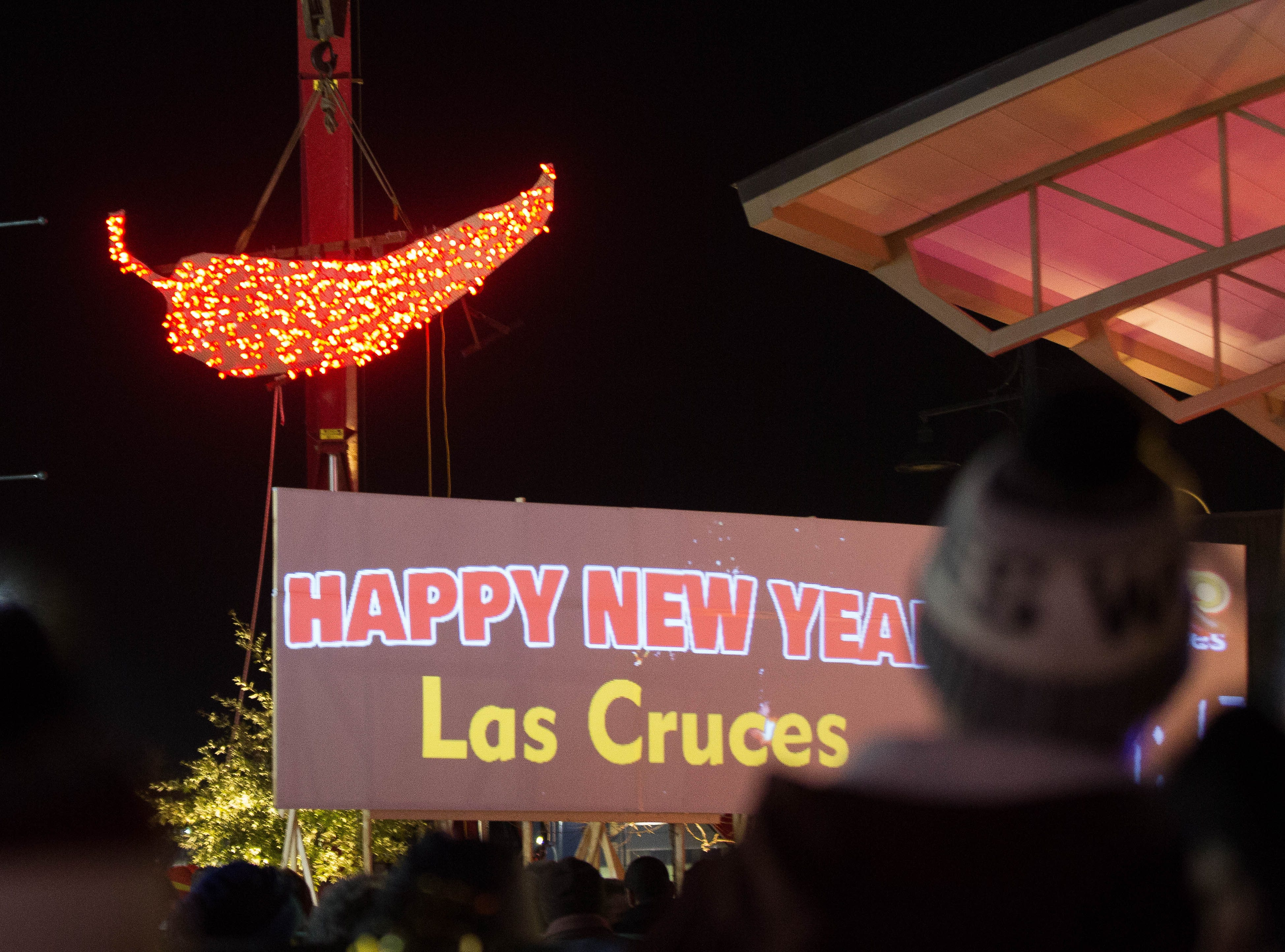 The crowd gathered at the Plaza de Las Cruces cheers as the Chile drops and turns red Tuesday January 1, 2019 at the turn of the New Year.