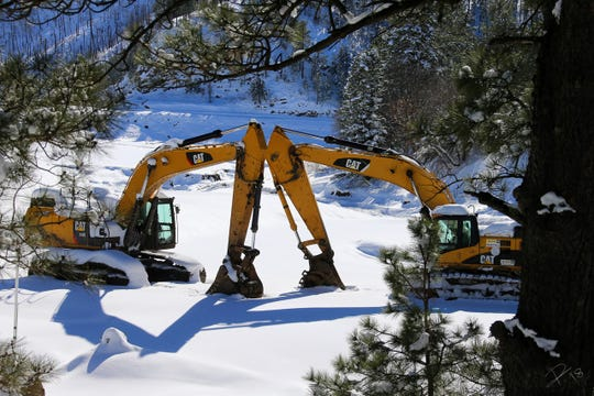 Equipment at Bonito Lake rests after a snow on the day after Christmas.