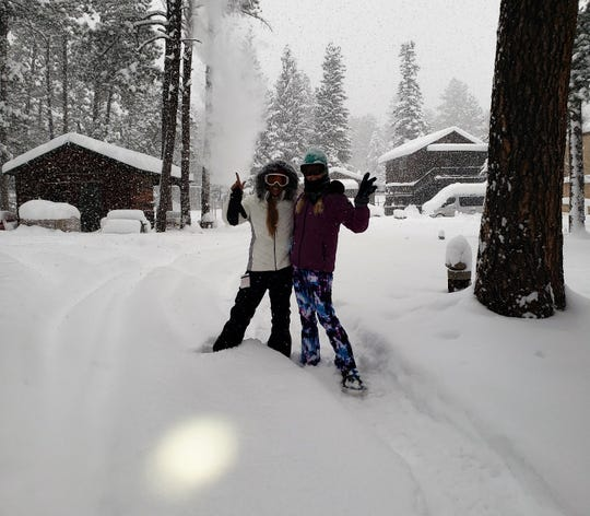Gracie And Anna Dozier return to Midtown Mountain Campground from their chilly winter hike through Ruidoso.