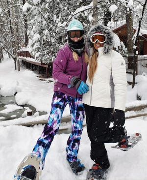 Anna Dozier and her daughter Gracie are ready for a wintry trek through Midtown Ruidoso.