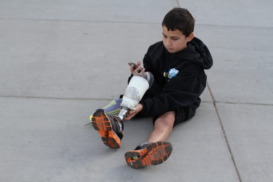 Adrian Grajeda, with his artificial leg, at Abraham Lincoln Elementary School in Palm Desert in February 2014.