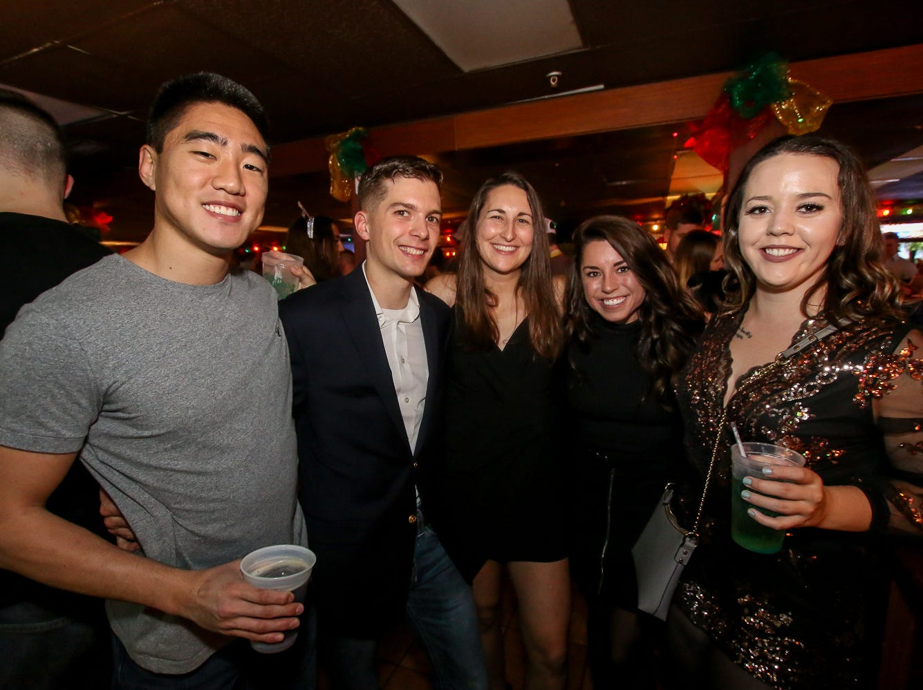 Revelers celebrate New Year's Eve at Perfect Plain Brewing Co., Old Hickory Whiskey Bar, O'Riley's Irish Pub, Seville Quarter, Intermission, and Blend Lounge on Monday, December 31, 2018.