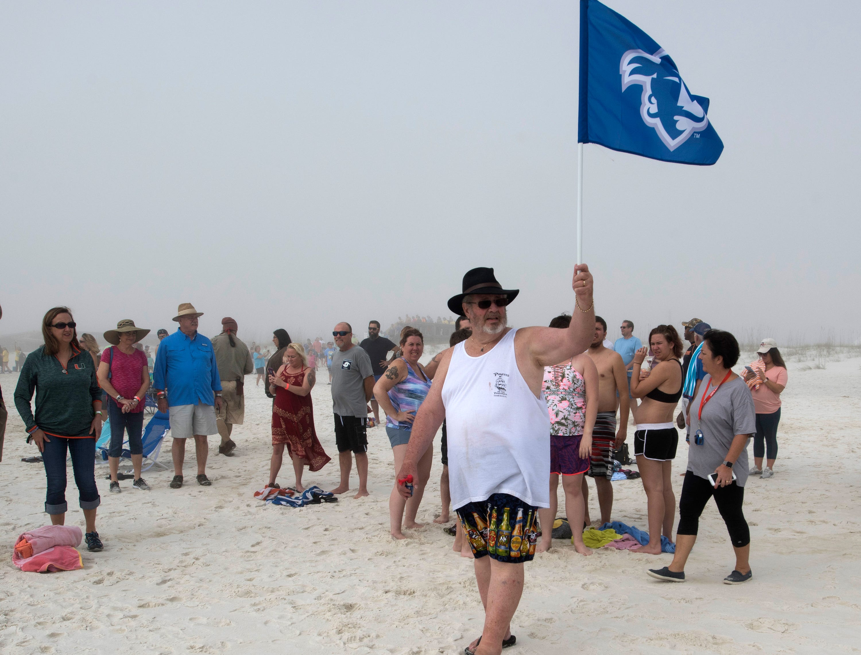 """""""Jersey"""" Jerry Foster, an organizer of the Navarre Beach Pirate Plunge makes a call for New Year's Day revelers to take their positions on the beach before heading into the Gulf of Mexico on the 2nd annual dip on Tuesday, Jan. 1, 2019."""