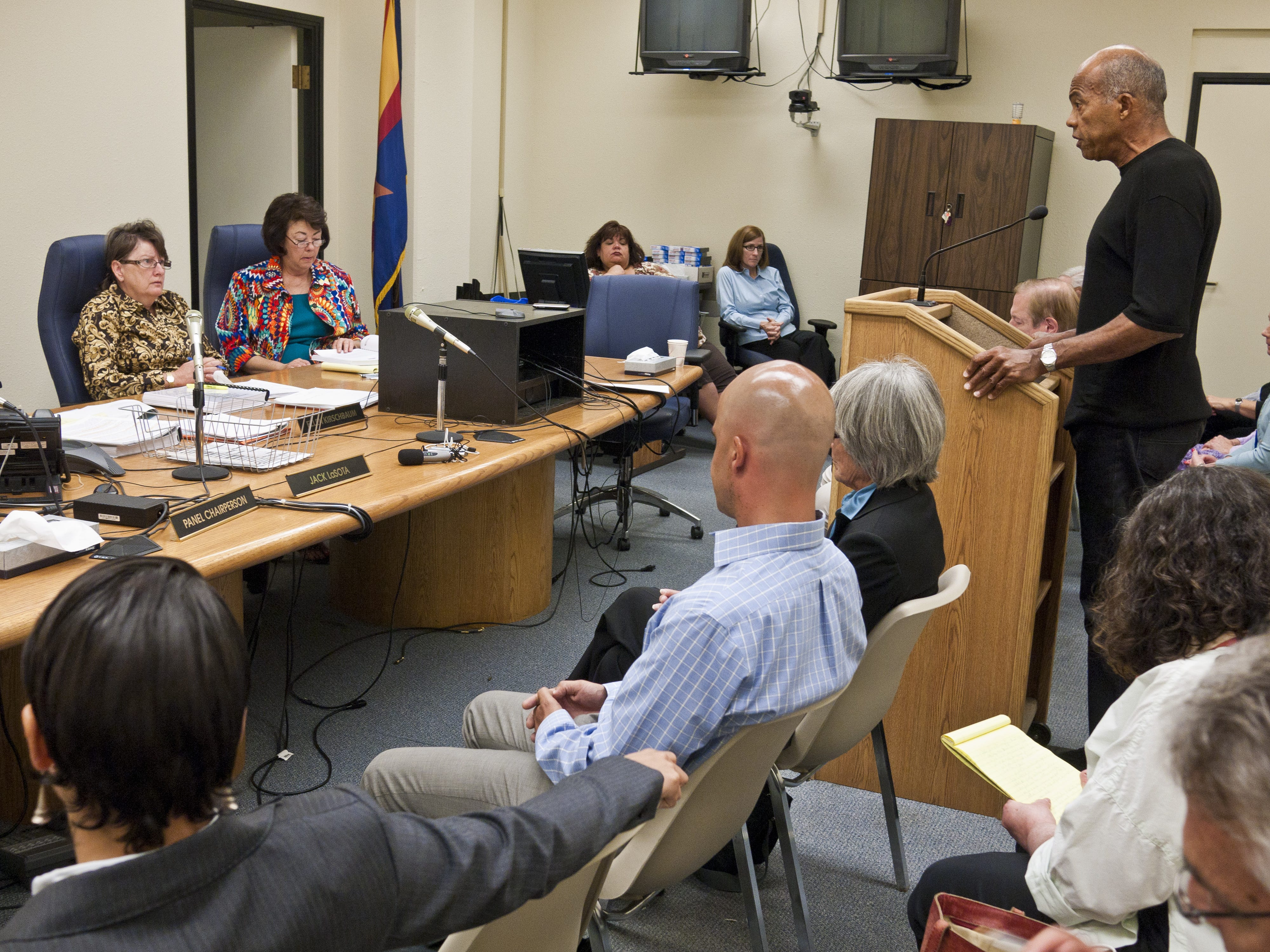"""John Edgar Wideman speaks on behalf of his son, Jacob Wideman, during Jacob's parole hearing at the Arizona Board of Executive Clemency in May 2011 in Phoenix. In August 1986, Jacob Wideman, then 16, stabbed another teen to death for no other reason than he """"had a bad year"""" while on a summer-camp-sponsored trip to Flagstaff."""