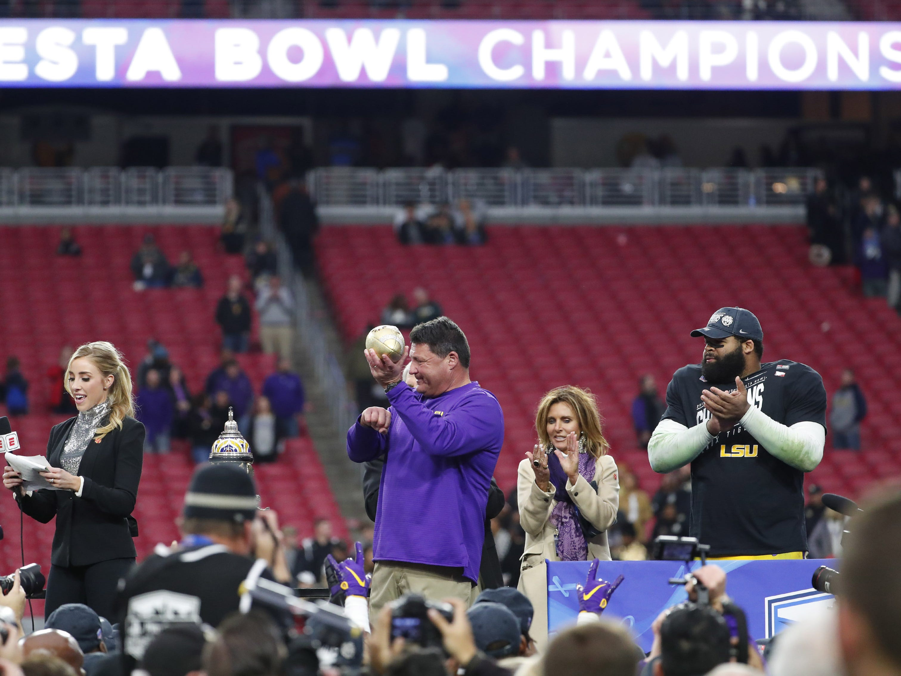 LSU head coach Ed Orgeron holds the Fiesta Bowl trophy after beating UCF in Glendale January 1, 2019. LSU won 40-32.