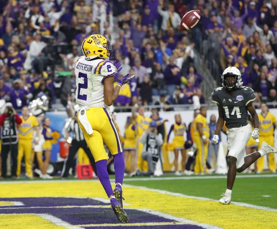 LSU wide receiver Justin Jefferson (2) catches a touchdown against UCF during the Fiesta Bowl in Glendale January 1, 2019.