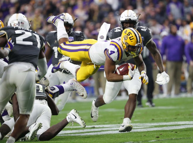 LSU running back Nick Brossette (4) is tripped up against UCF during the Fiesta Bowl in Glendale January 1, 2019.