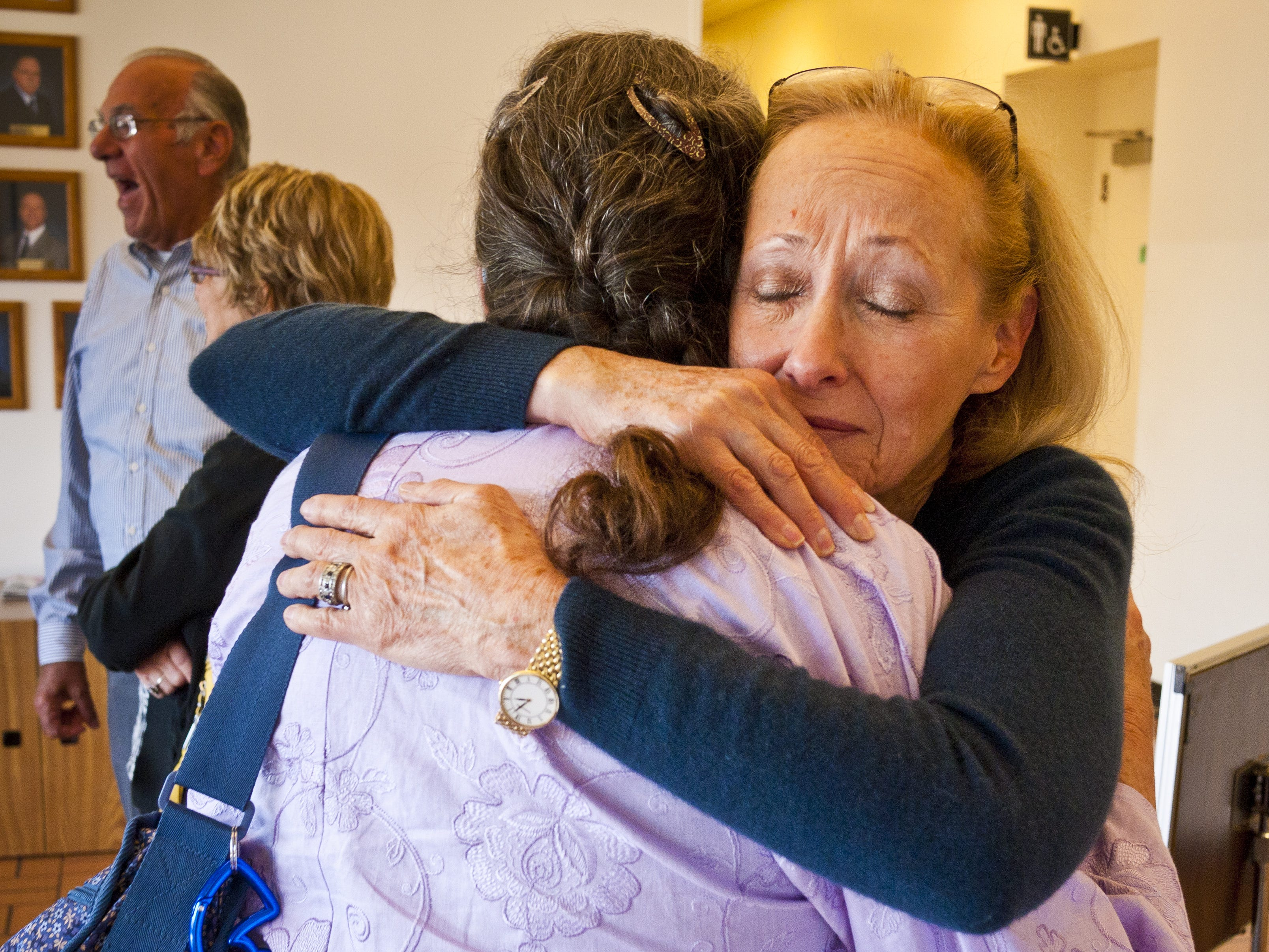 Louise Kane is comforted by Paulene Thompson, a family friend, in May 2011 after parole was denied for Jacob Wideman, who killed Kane's son, Eric, at the Arizona Board of Executive Clemency (Parole Board) in Phoenix.