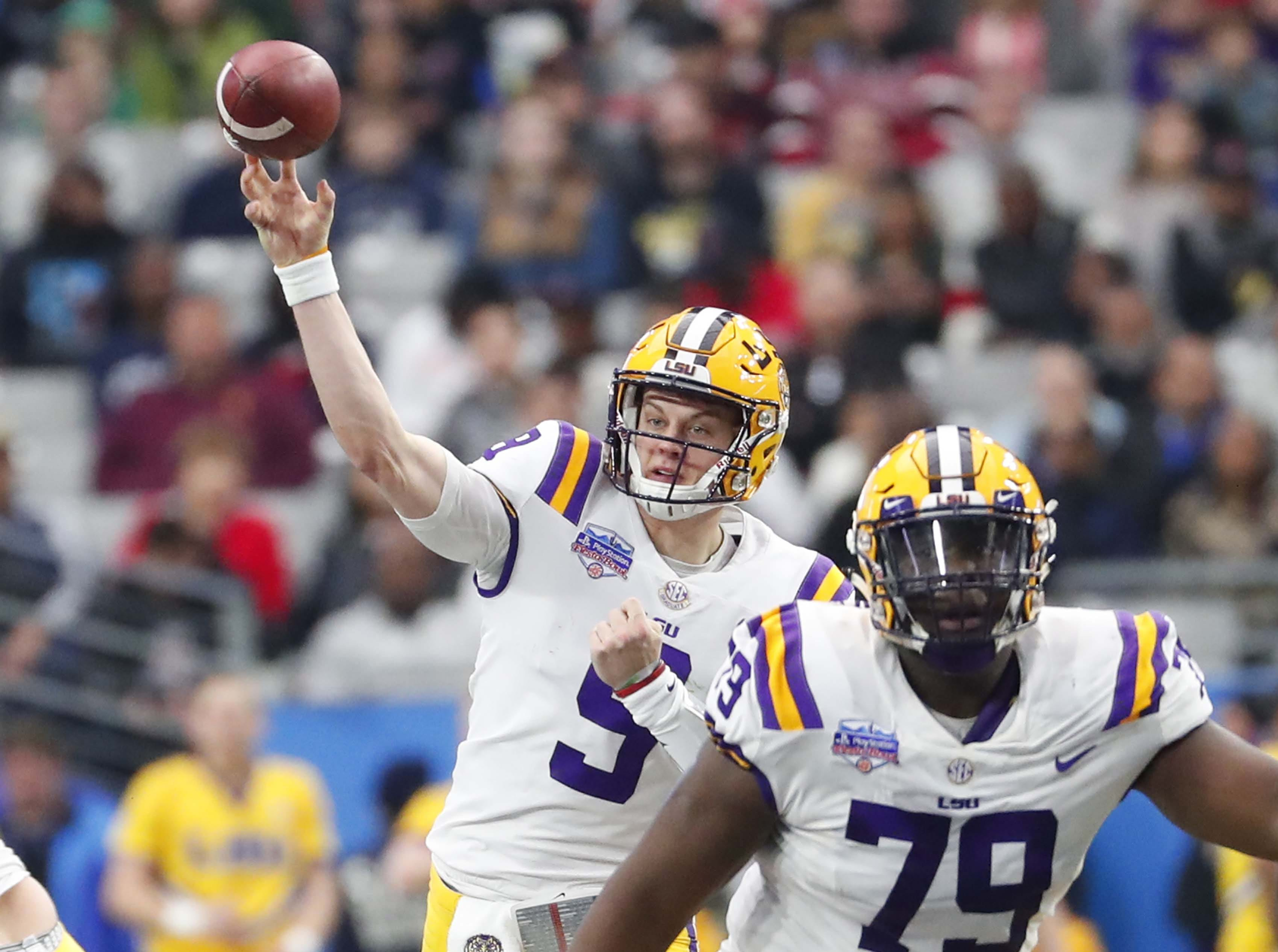 LSU quarterback Joe Burrow (9) throws against UCF during the Fiesta Bowl in Glendale January 1, 2019.
