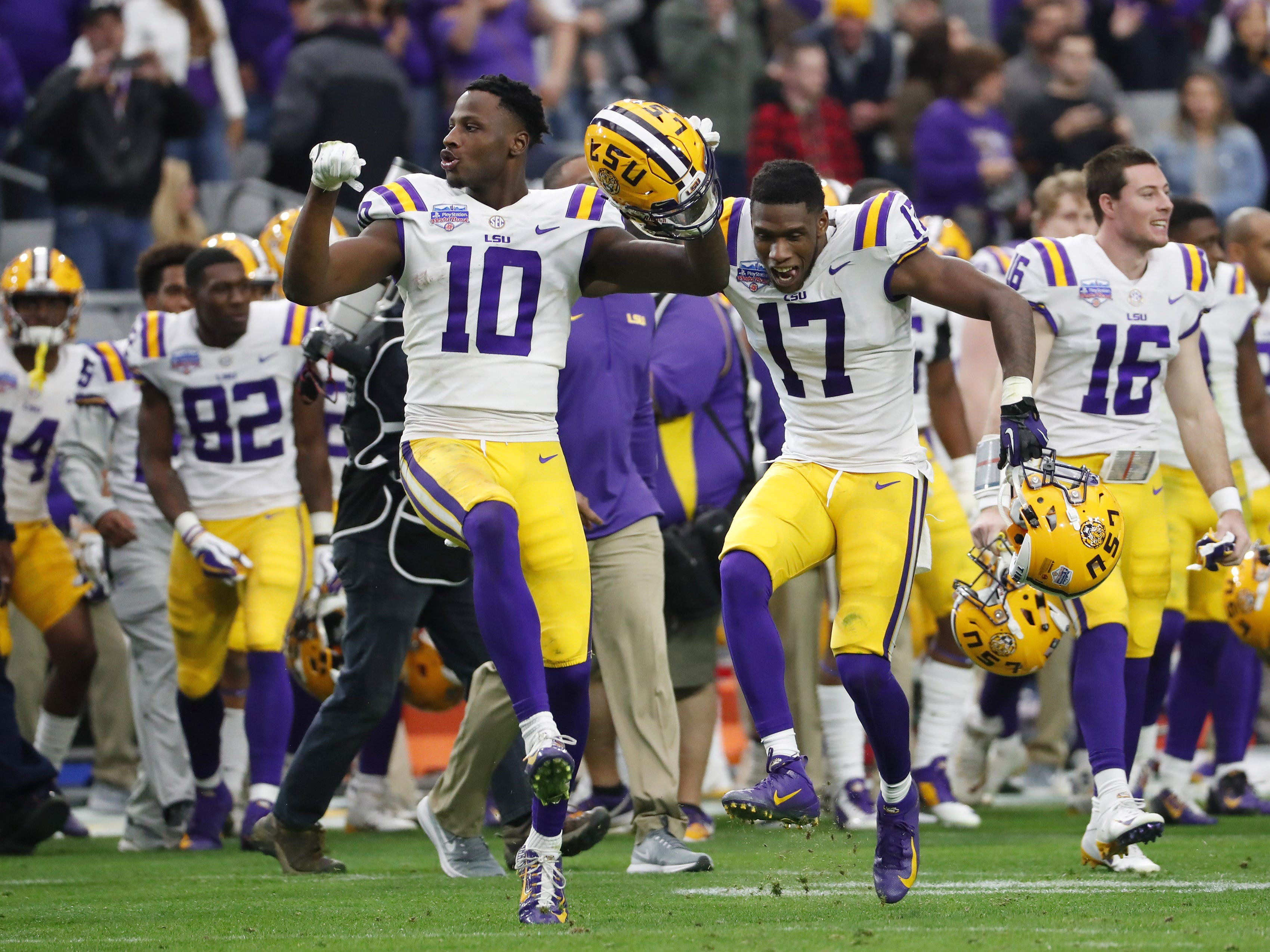 LSU wide receivers Stephen Sullivan (10) and Racey McMath (17) celebrate after winning the Fiesta Bowl in Glendale January 1, 2019. LSU won 40-32.