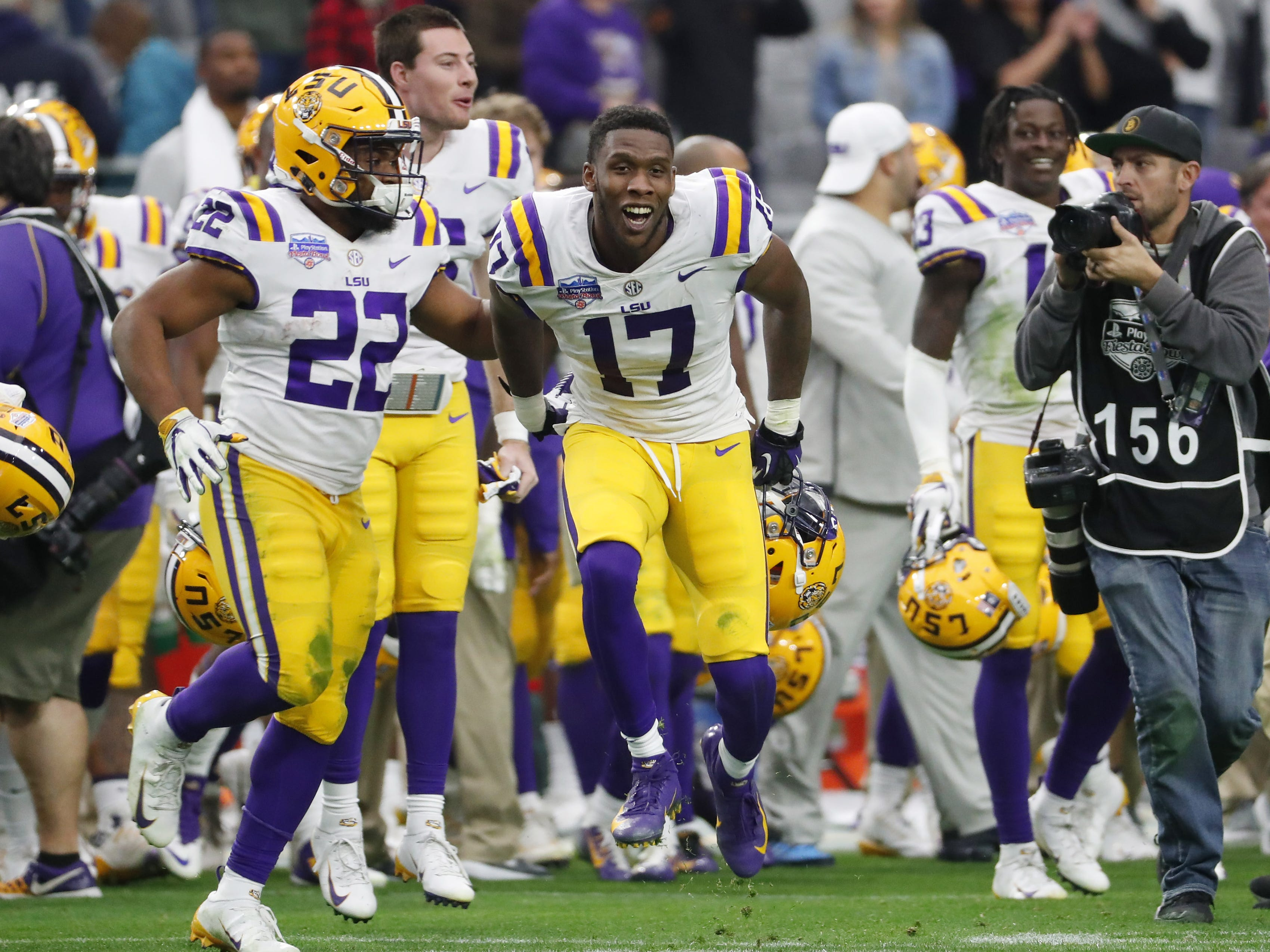 LSU players celebrate after beating UCF in the Fiesta Bowl in Glendale January 1, 2019. LSU won 40-32.