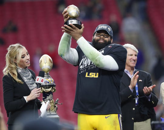 LSU defensive end Rashard Lawrence holds the defensive player of the game after winning the Fiesta Bowl in Glendale January 1, 2019. LSU beat UCF 40-32.
