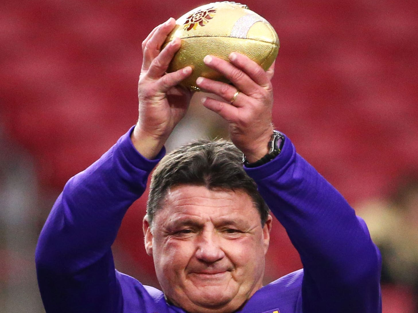 LSU Tigers head coach Ed Orgeron lifts the trophy after defeating the UCF Knights 40-32 at the Fiesta Bowl on Jan. 1 at State Farm Stadium.