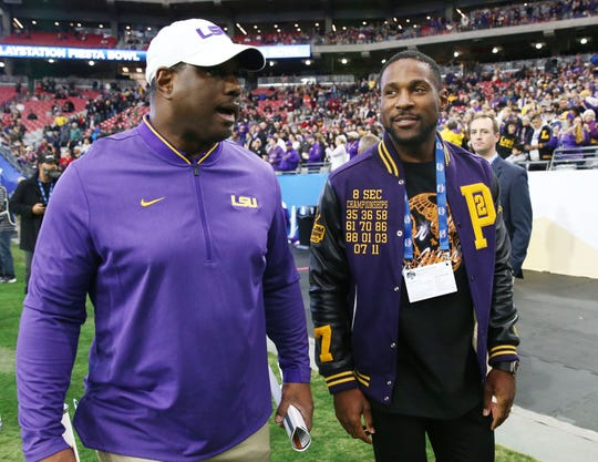LSU Tigers alumnus Patrick Peterson visits the sidelines at the Fiesta Bowl on Jan. 1 at State Farm Stadium.