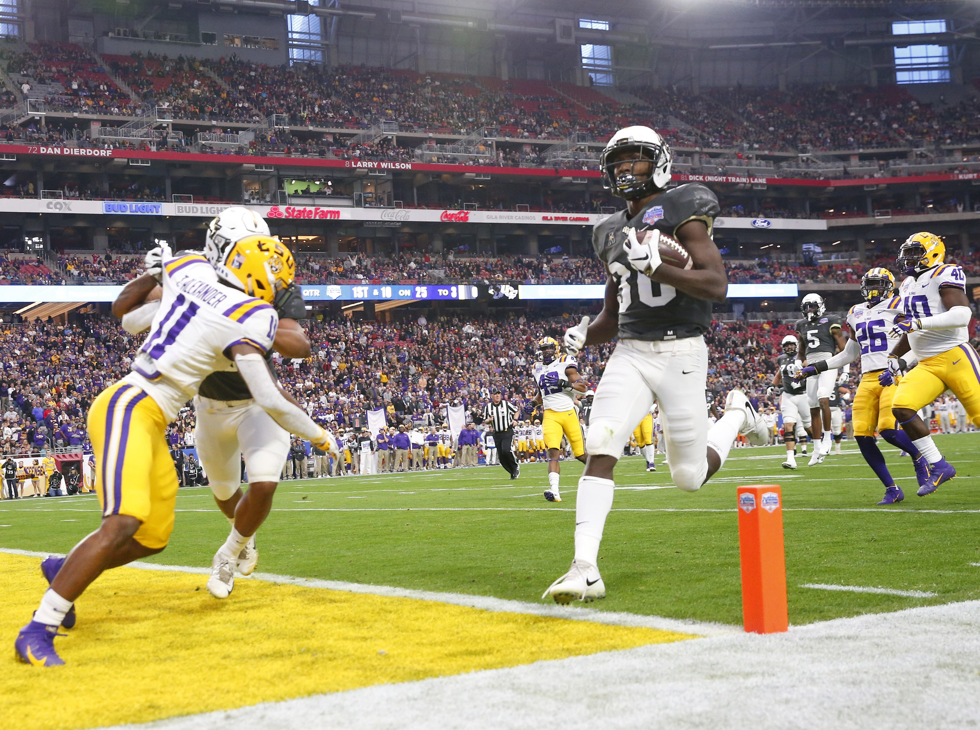 LSU wide receiver Michael Ostrom (30) runs in for a touchdown against LSU during the Fiesta Bowl in Glendale January 1, 2019.