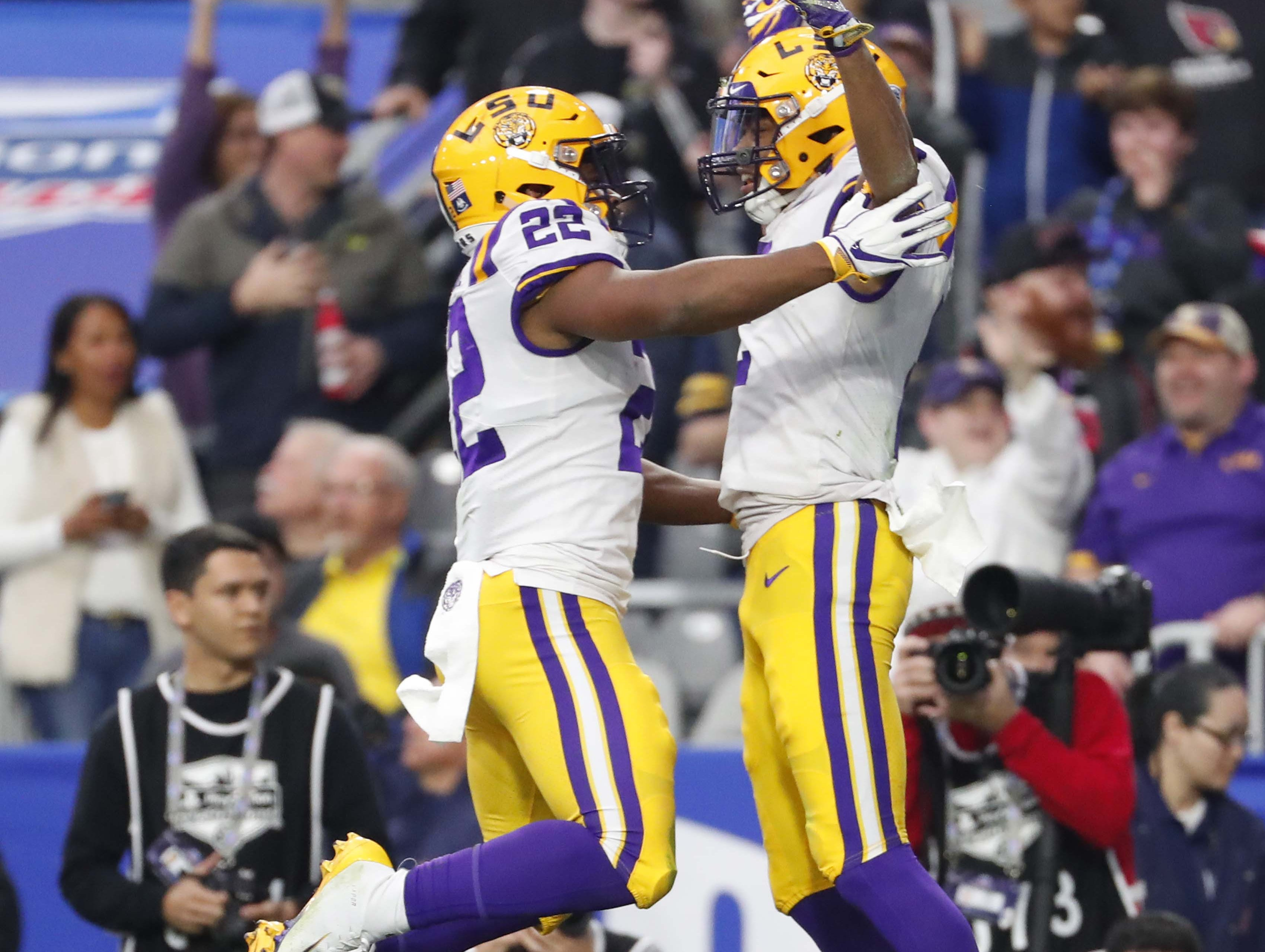 LSU wide receiver Justin Jefferson (right) celebrates his touchdown catch with running back Clyde Edwards-Helaire (22) against UCF during the Fiesta Bowl in Glendale January 1, 2019.