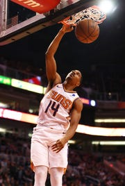 Dec 31, 2018; Phoenix, AZ, USA; Phoenix Suns guard De'Anthony Melton (14) dunks the ball in the first quarter against the Golden State Warriors at Talking Stick Resort Arena. Mandatory Credit: Mark J. Rebilas-USA TODAY Sports