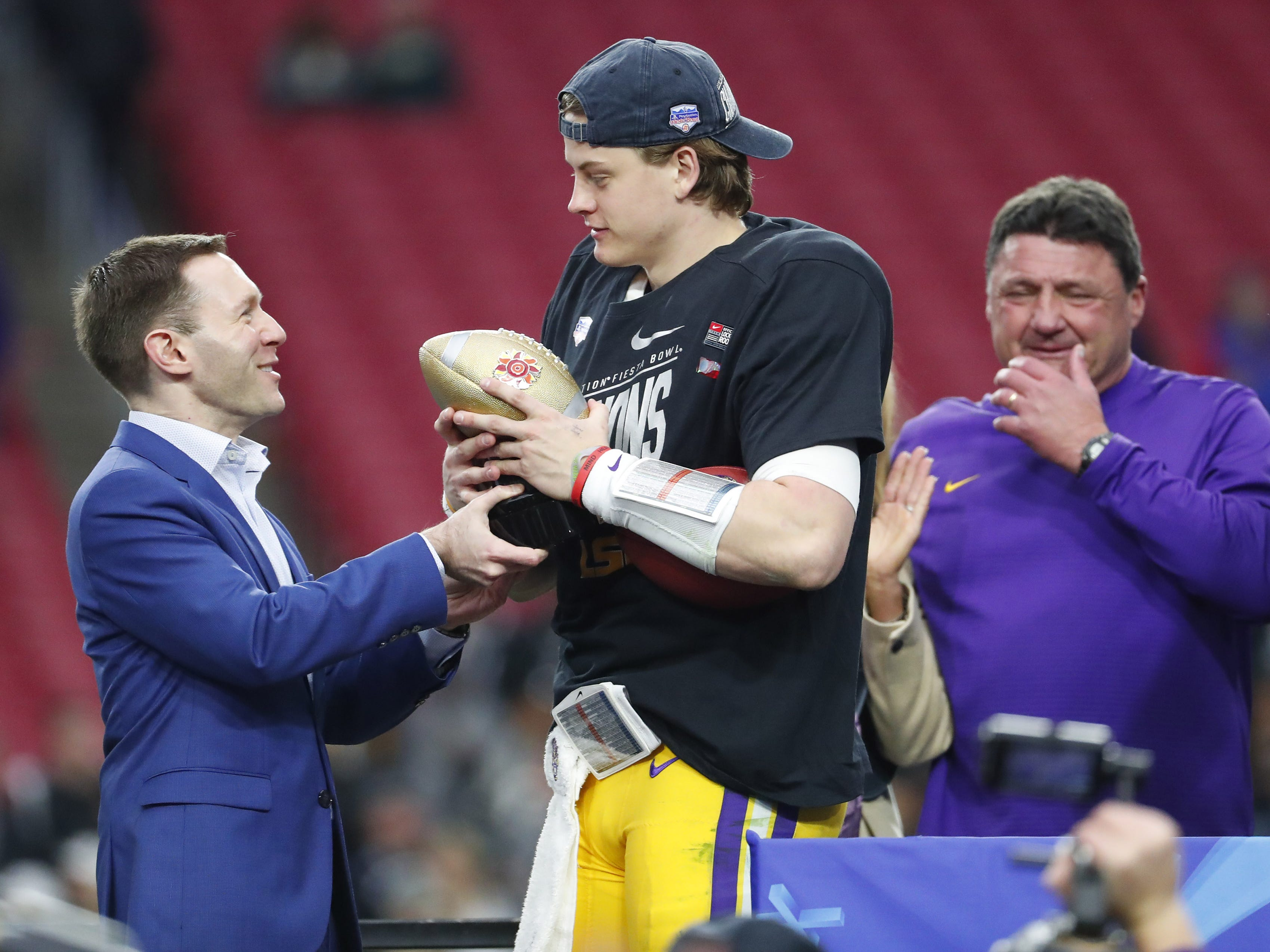 LSU quarterback Joe Burrow accepts the offensive player of the game after winning the Fiesta Bowl in Glendale January 1, 2019. LSU beat UCF 40-32.