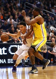 Dec 31, 2018; Phoenix, AZ, USA; Phoenix Suns guard Devin Booker (1) controls the ball against Golden State Warriors forward Kevon Looney (5) in the first half at Talking Stick Resort Arena. Mandatory Credit: Mark J. Rebilas-USA TODAY Sports