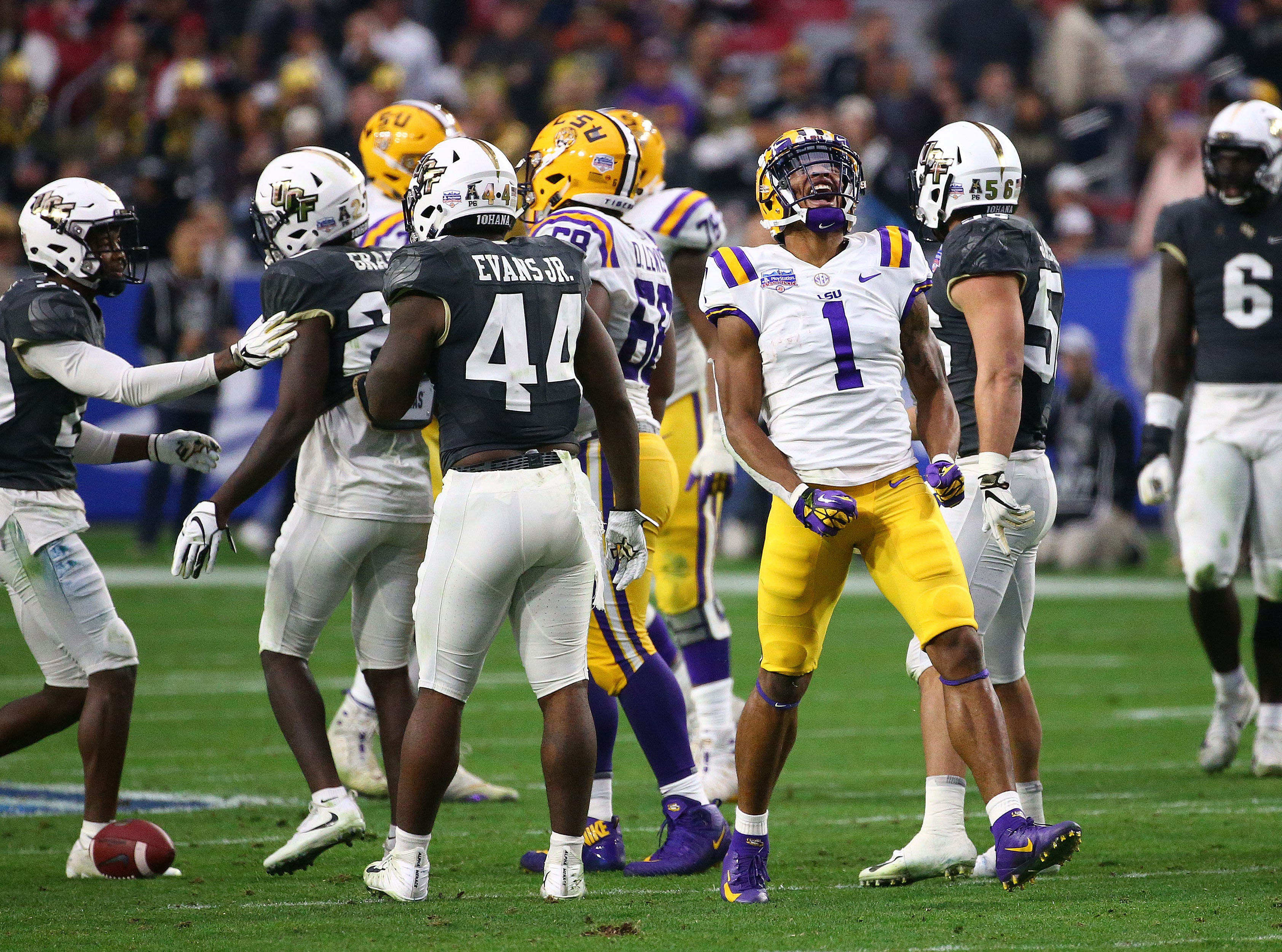 LSU Tigers wide receiver Ja'Marr Chase (1) reacts after making a first down against the UCF Knight in the first half at the Fiesta Bowl on Jan. 1 at State Farm Stadium.