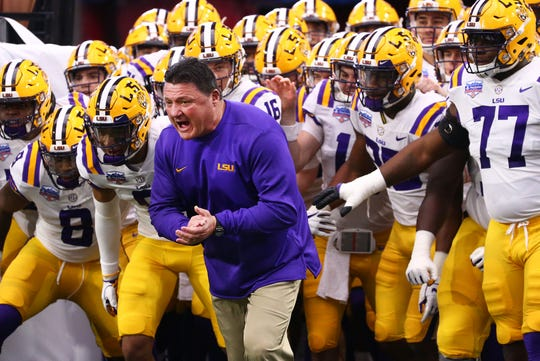LSU Tigers head coach Ed Orgeron takes the field to play the UCF Knights at the Fiesta Bowl on Jan. 1 at State Farm Stadium.